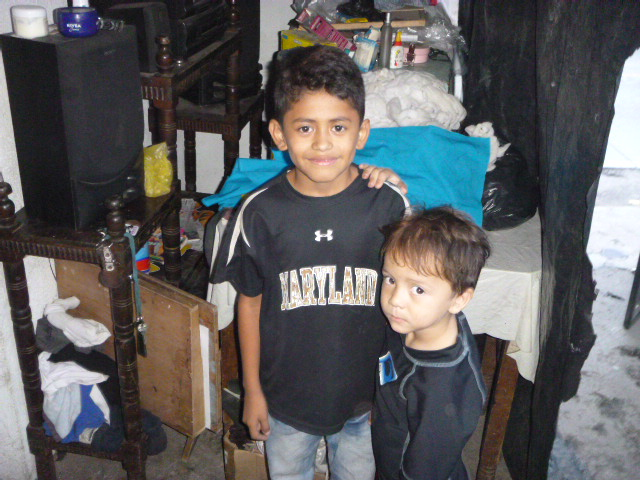 Jeferson and his brother at home