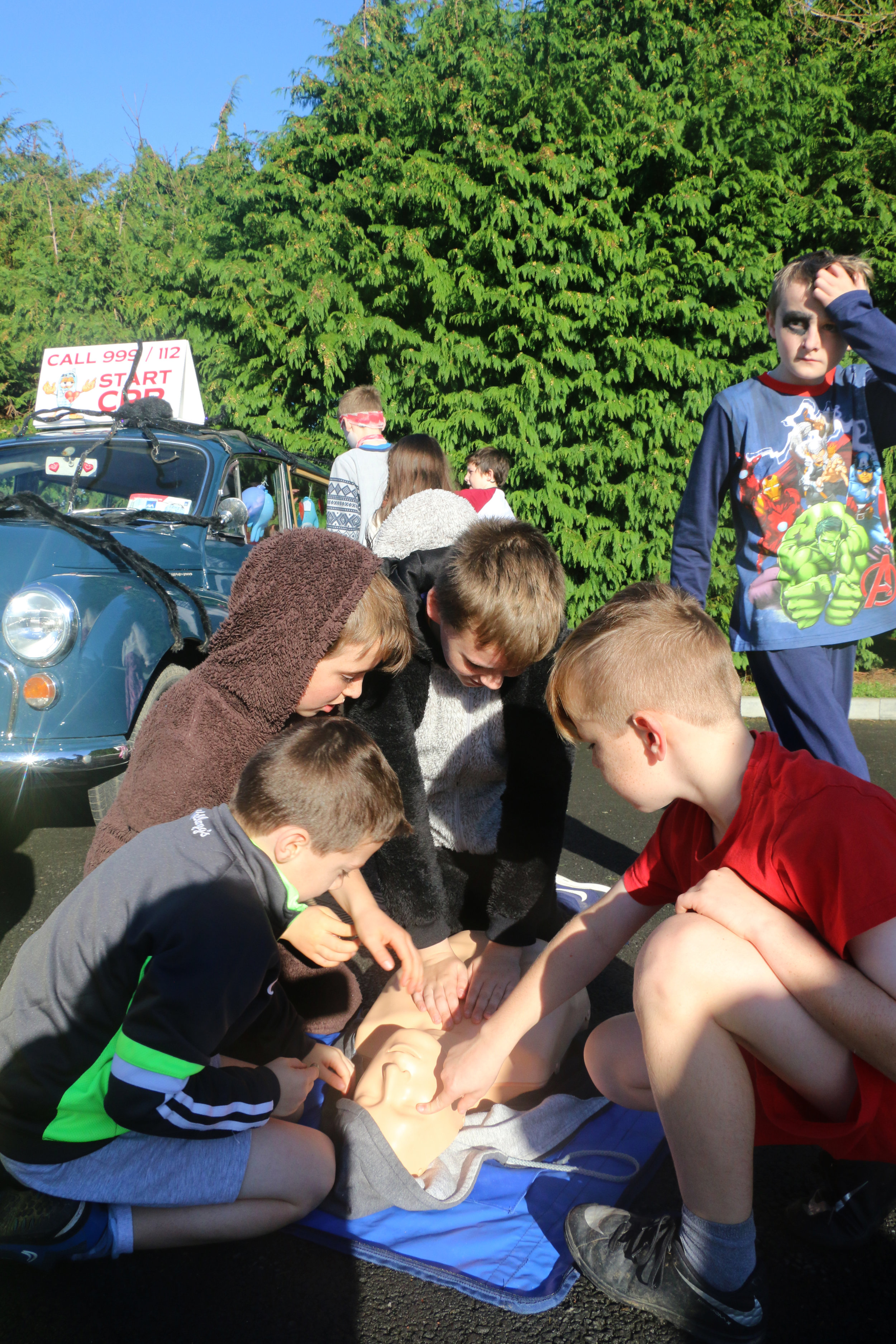 Photo13-Kids-teaching-each-other-IMG_5048.jpg