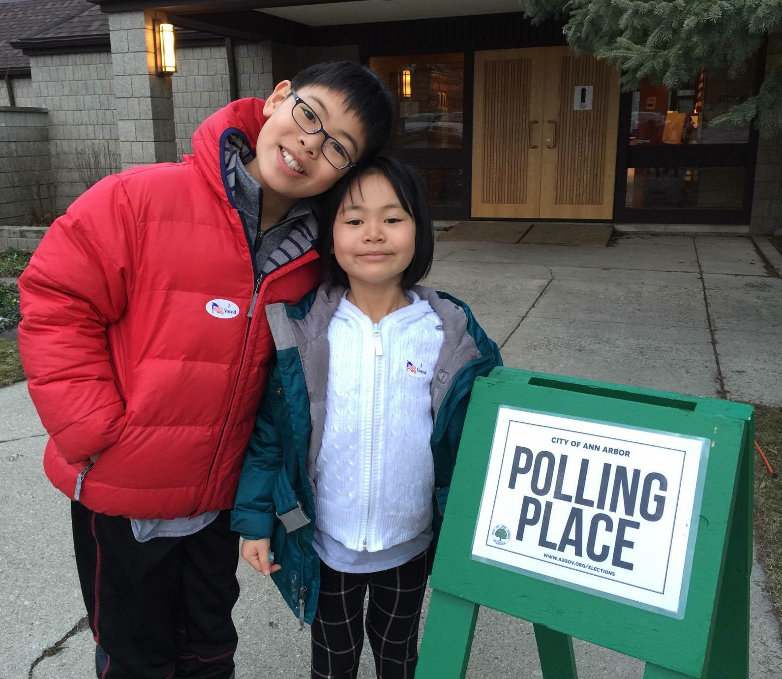 Jaegun and Quynh Song outside the polling place at First United Methodist Church on Green Road (Ward 2, Precinct 8).