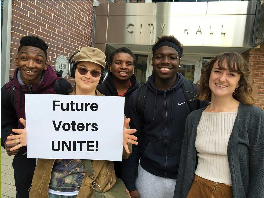 Neutral Zone teens in front of Ann Arbor city hall. From left: King Ogundipe, KZ Jarrard, Dalon Brown, Deondrick McLilly, and Cassandra Van Dam.