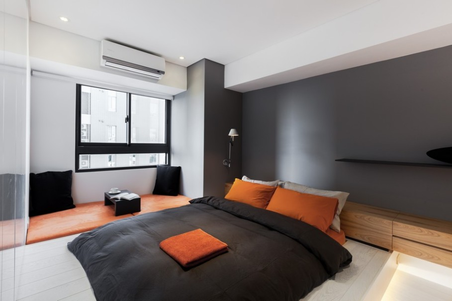 Dark grey painted Wall as the focal point in this warm, modern apartment.