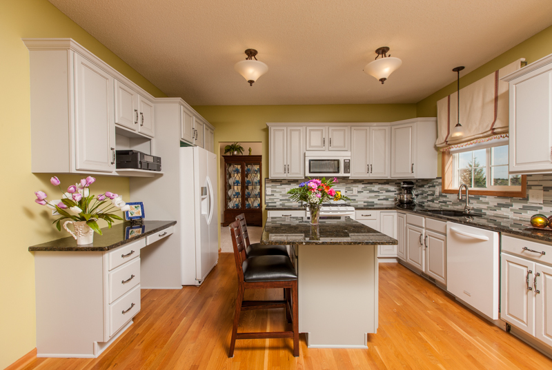 Refinished cabinets by Elite Finisher.