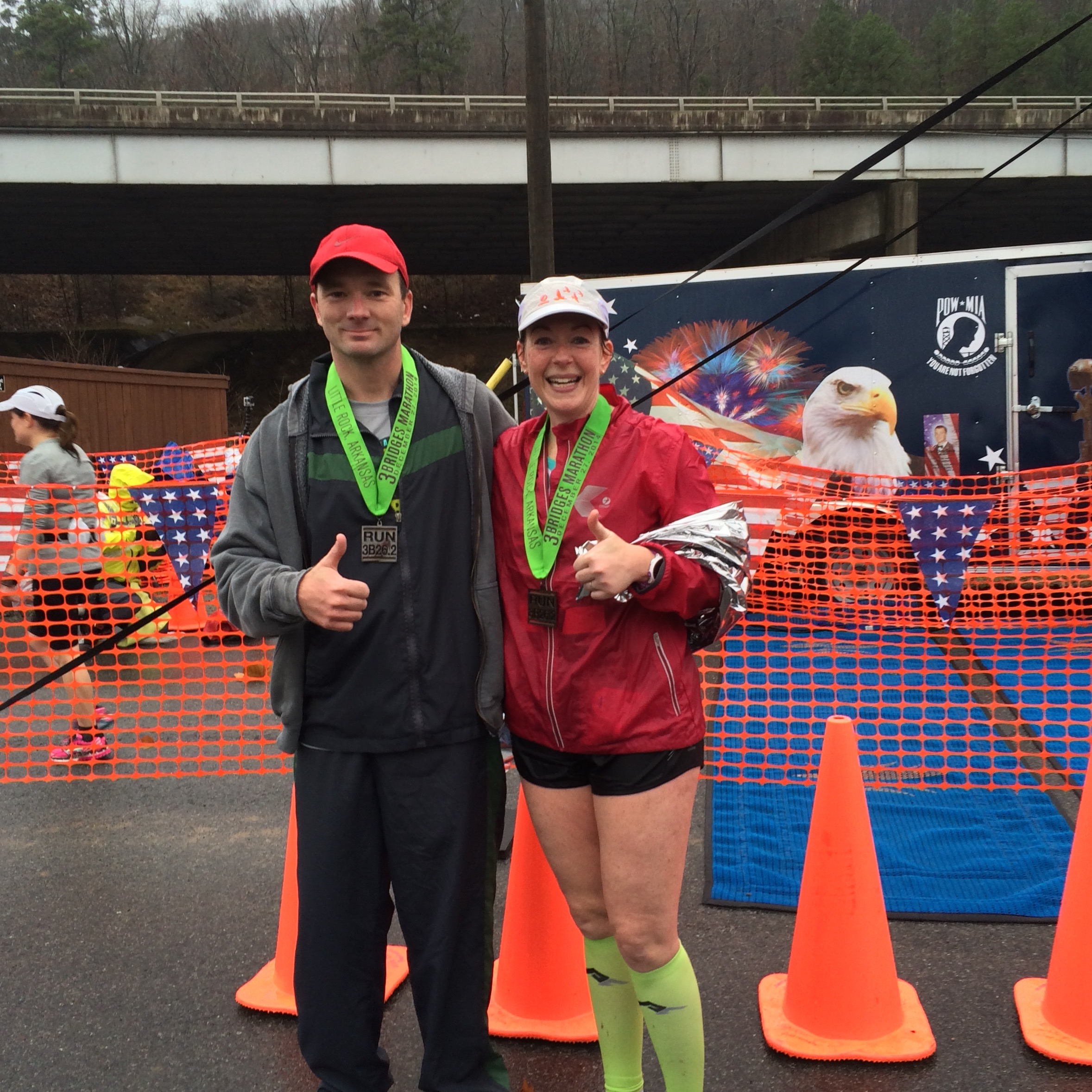 At the finish line of my first marathon, the 2014 Jacob Wells 3 Bridges Marathon, with Chris.