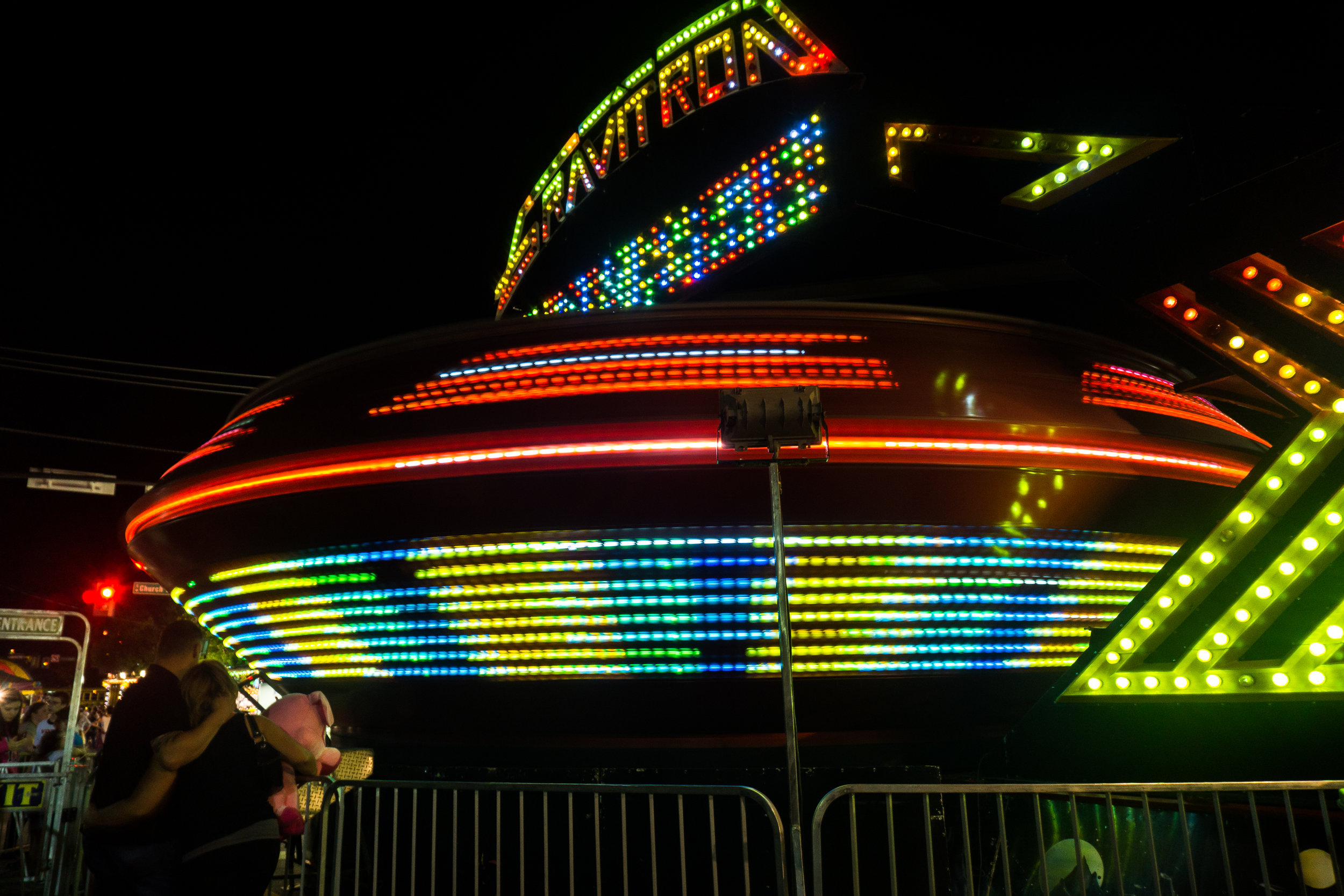 A couple watches the Gravitron spin Friday night at the Ephrata Fair.