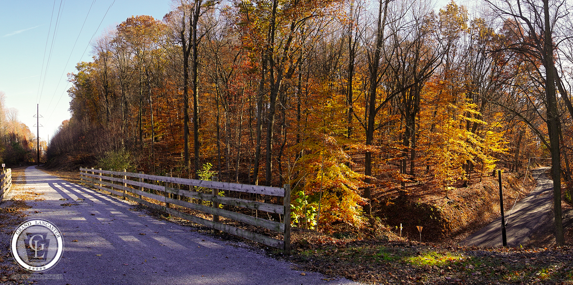 This wide panoramic shot shows the Enola Low Grade Trail headed east over Hollow Road in Providence Township.