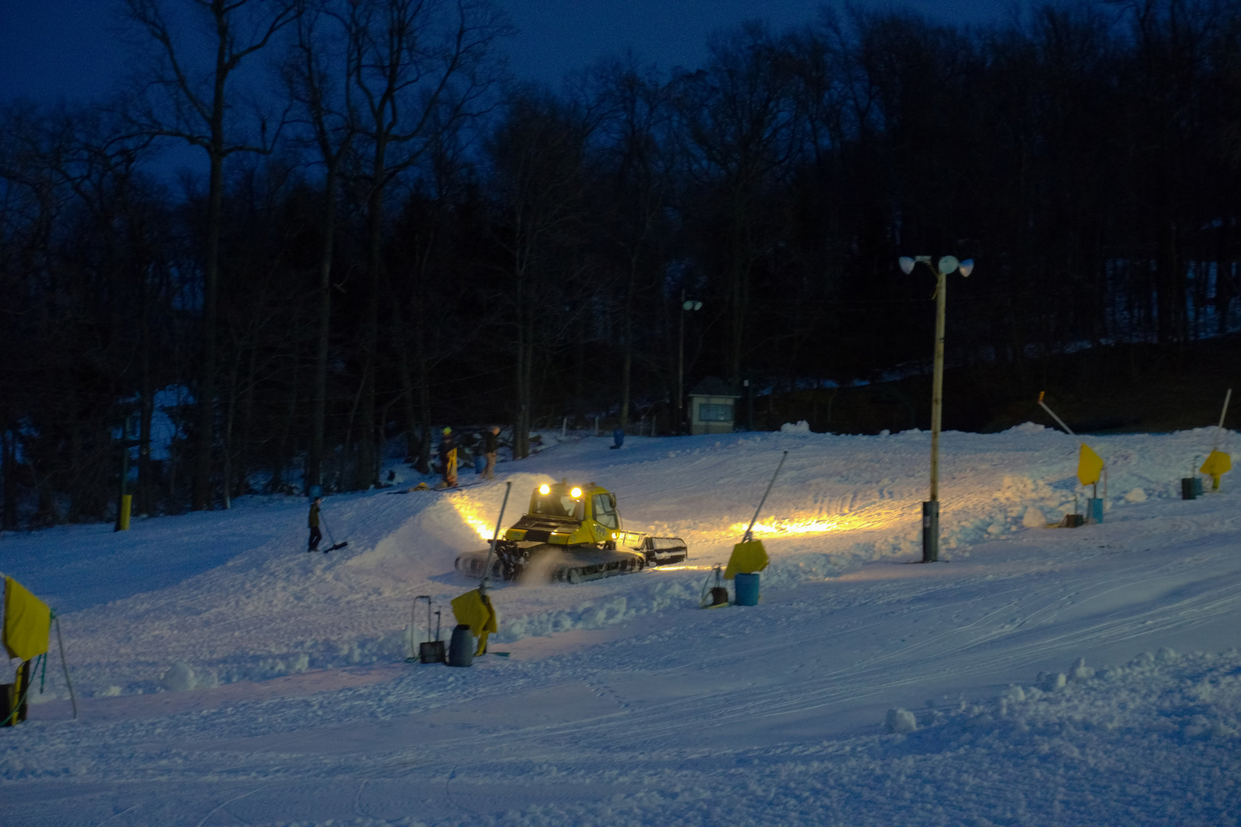 Snow crews working on the Terrain Park the night before opening day.