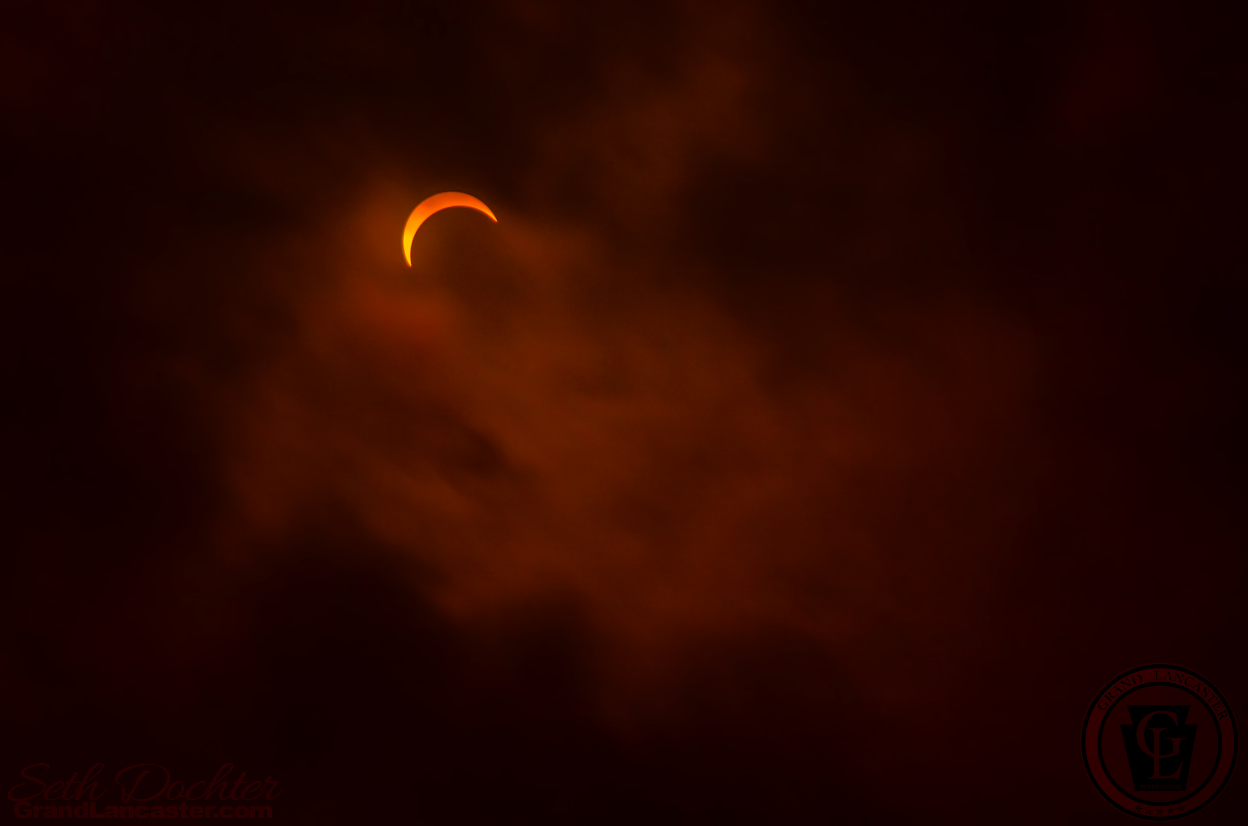 Wisps of clouds passing in front of the eclipse at it's peak in northern West Virginia 8.21.17