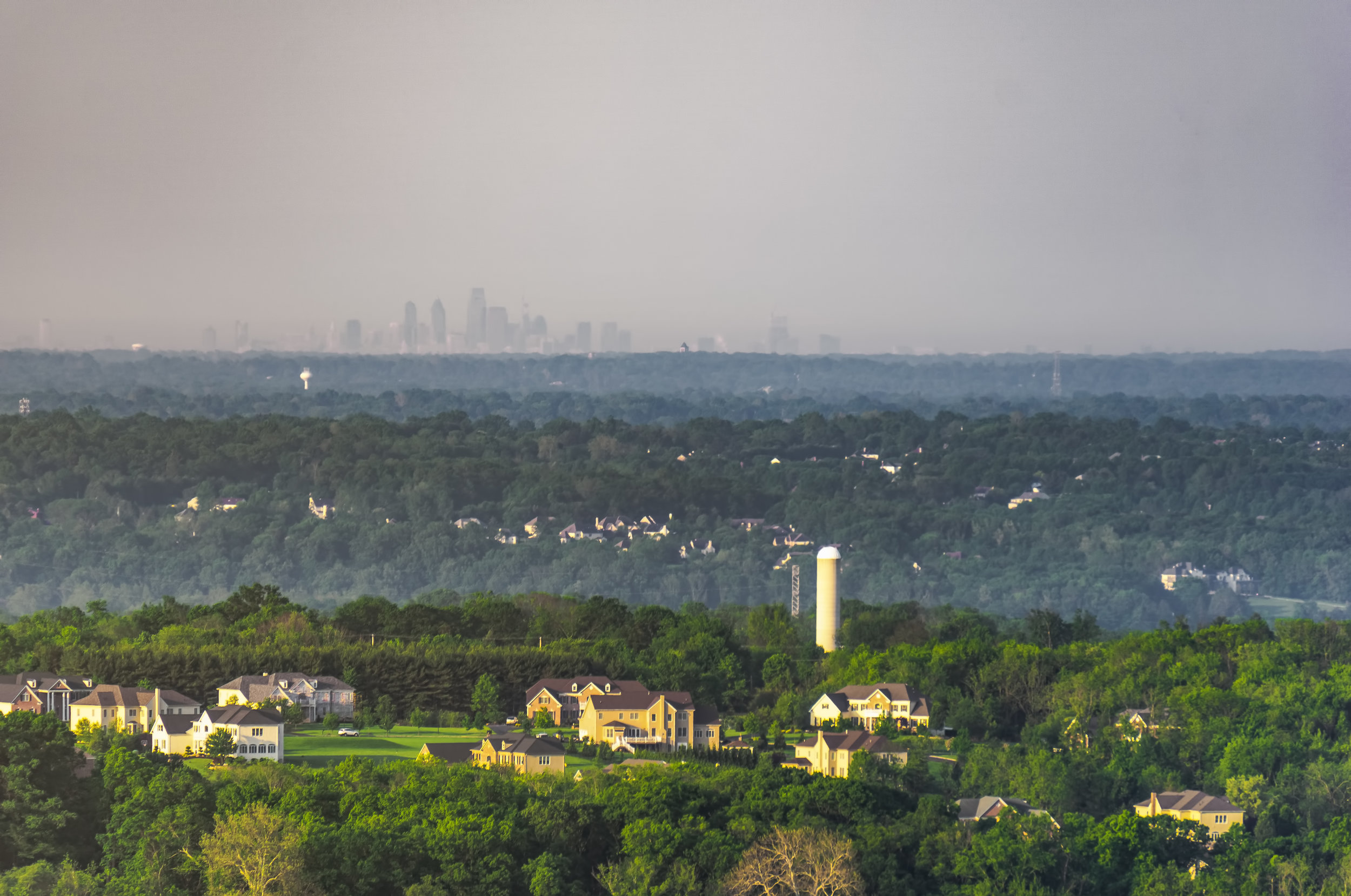 The Philadelphia Skyline lying beyond the rolling hills of Bucks County.