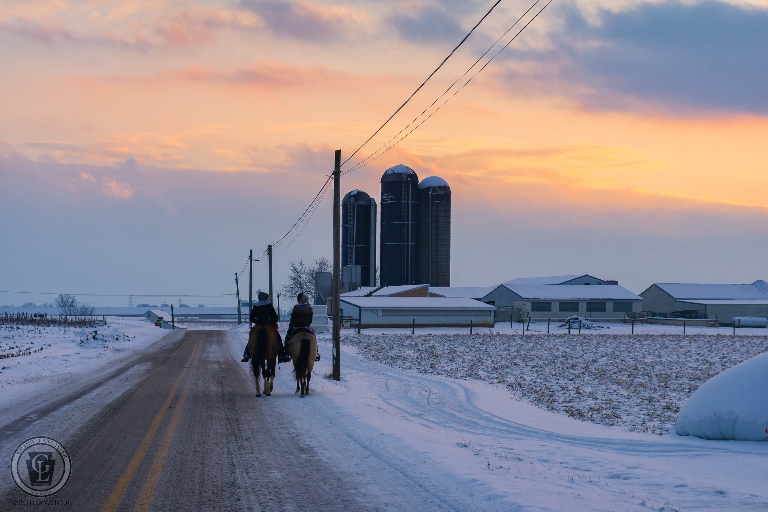 Two young ladies enjoying a sunset stroll on horseback on Wissler Road