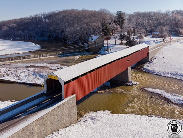 Stopped by the Pine Grove Covered Bridge on Wednesday. Located on the south eastern edge of Lancaster County this is the counties longest covered bridge at 204 feet and the only one spanning the county line. Could never get the shot I  wanted from the ground and thought the snow would be a good time to return. #dronelife #pinegrovecoveredbridge #coveredbridge #bridgesofinstagram #bridge #snow #octorarocreek #lancastercounty #chestercounty #grandlancaster #pennlive #uncoveringpa #lancastergram #madeinpennsylvania #pennsylvania #djiglobal #mavicair #djimavicair #dronedaily #dronestagram #dronephotography #country_features #rsa_rural #rural_love #creek #ic_water #wanderlust #winter