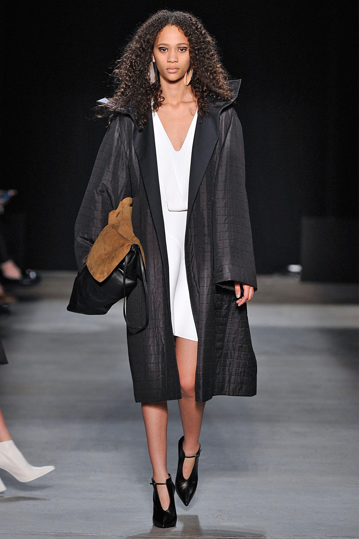 Look 7 Onyx laminated matelassé grid coat over chalk crepe dress.