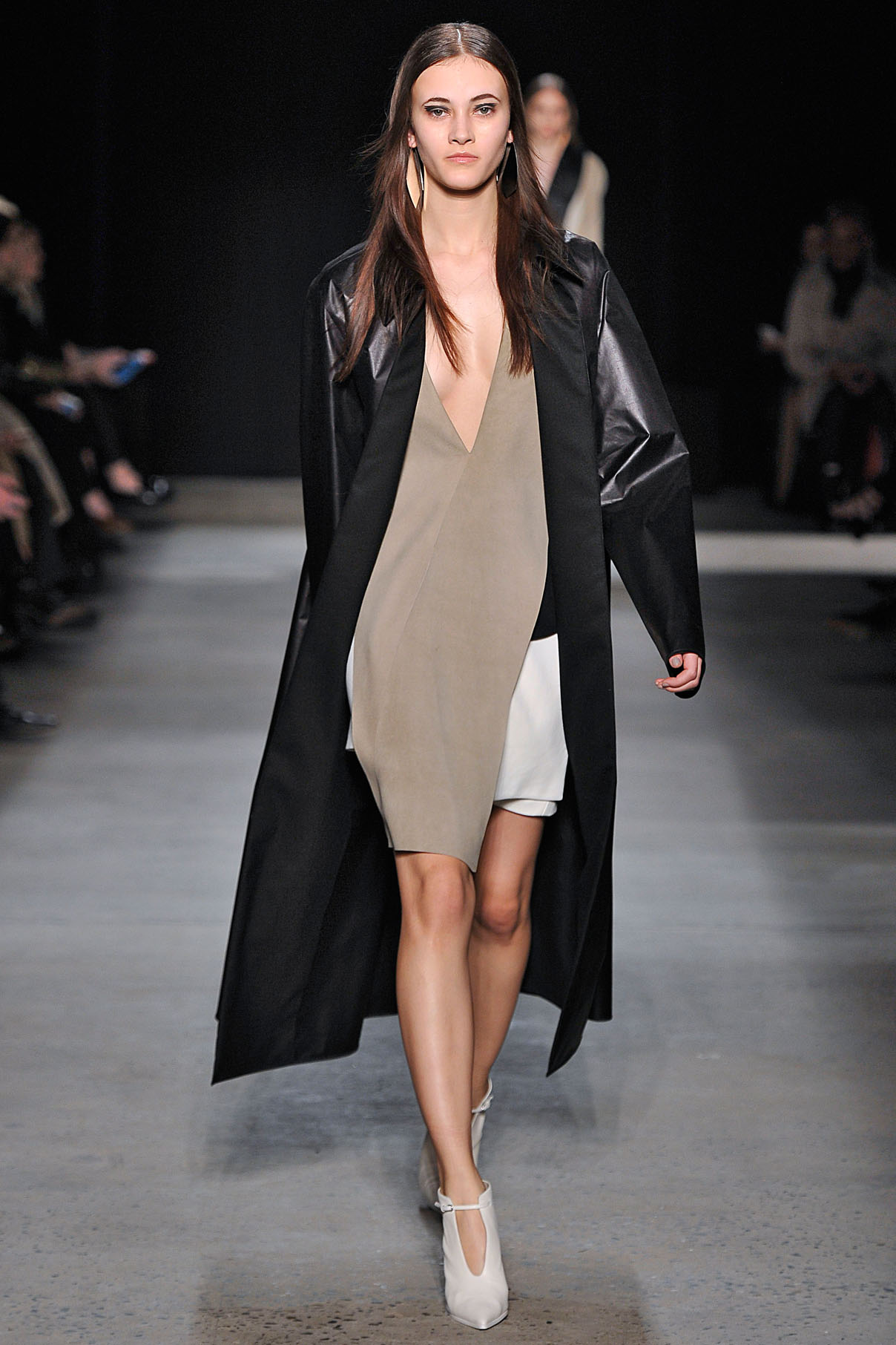 Look 12 Onyx bonded lacquer paper silk coat over stone suede harness top with chalk double wool crepe panel skirt.