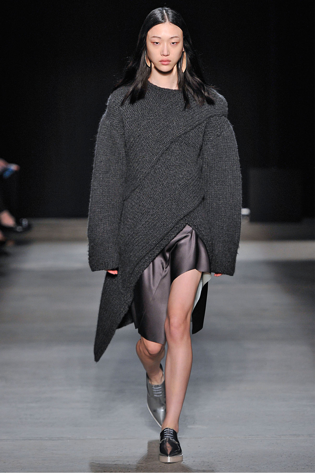 Look 21 Granite cashmere handknit sweater with black silk top and gunmetal/aquamarine bonded silk skirt.