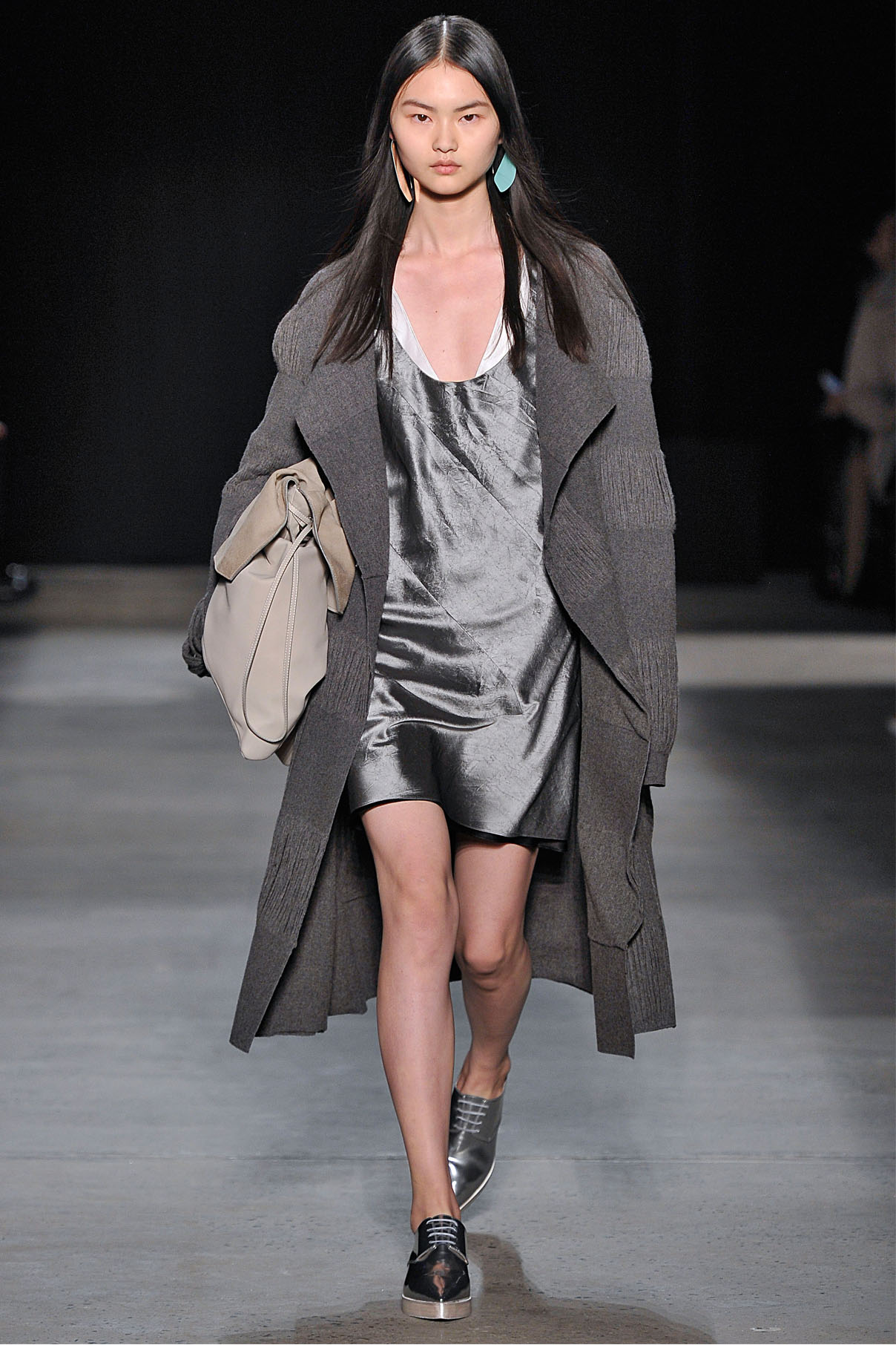 Look 25 Granite reverse wool yarn jacquard coat with aluminum crushed paper silk layer dress.