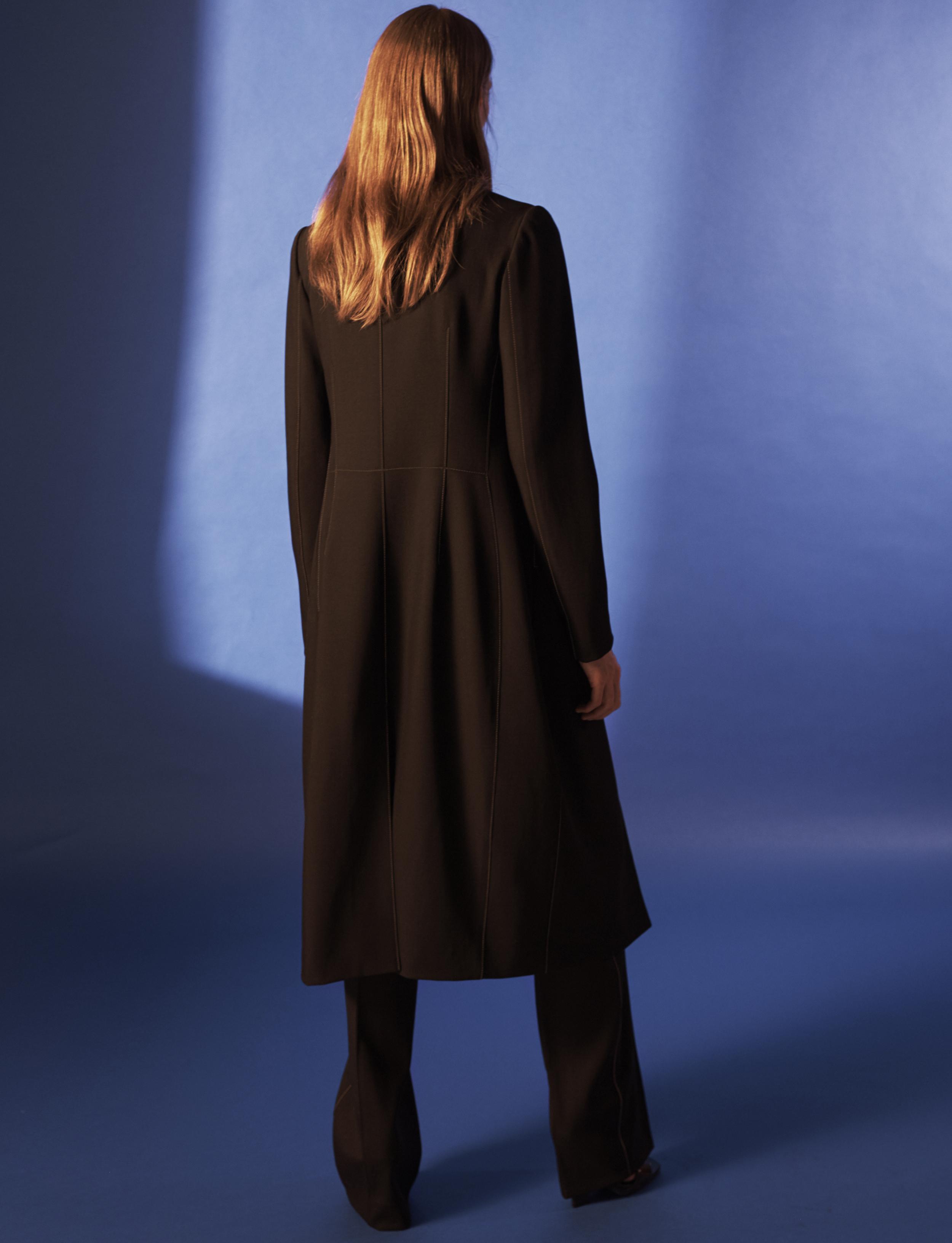 Look 6 Black wool gabardine coat with black wool gabardine pant.