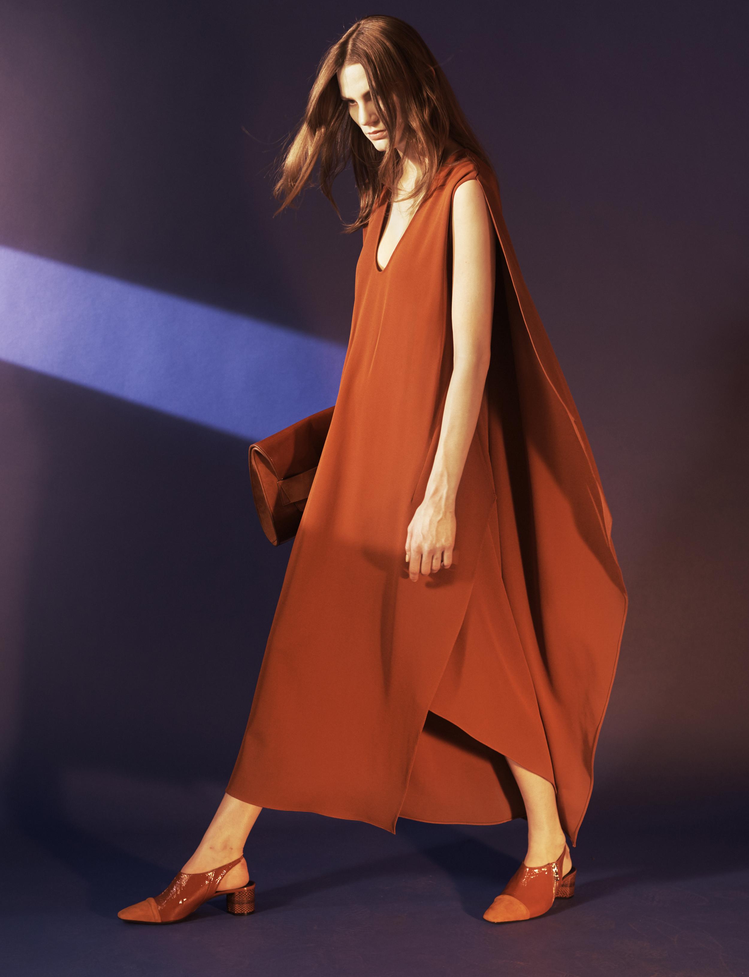 Look 11 Rust silk crepe cape dress.