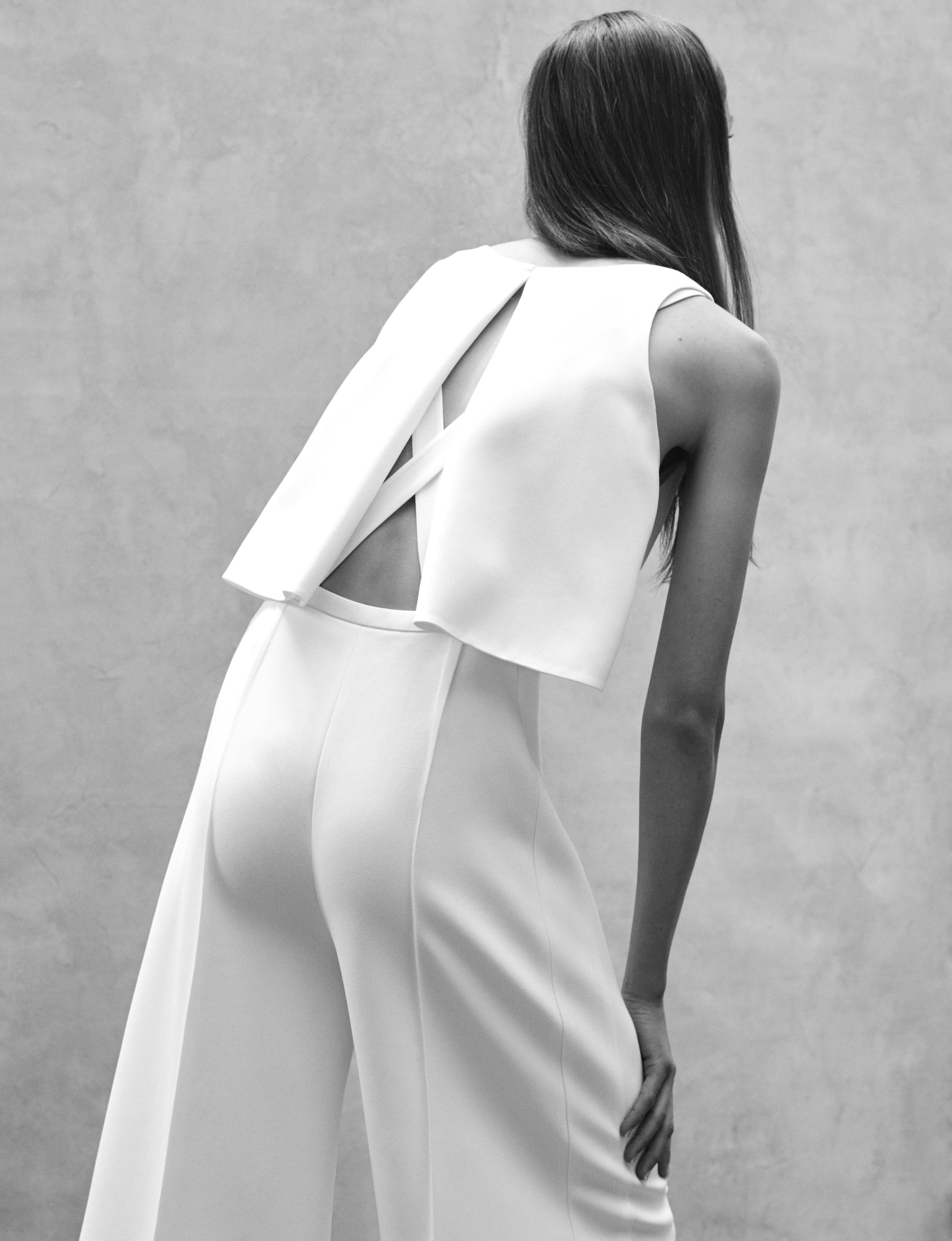 Look 2 White viscose crepe harness back jumpsuit.