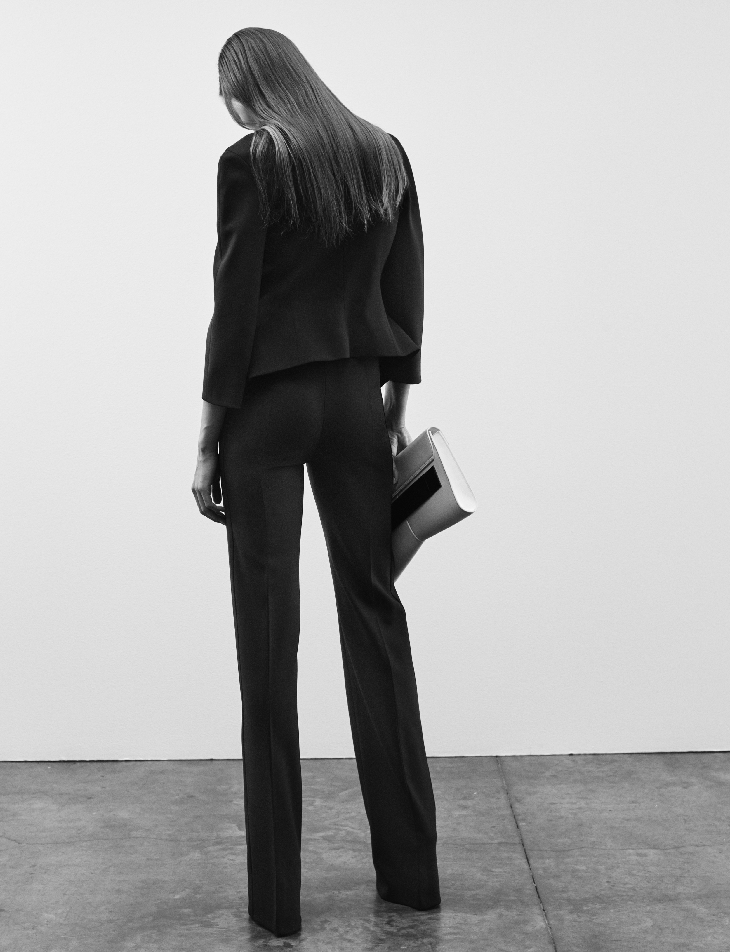 Look 14 Black wool gabardine jacket with black wool gabardine pant.