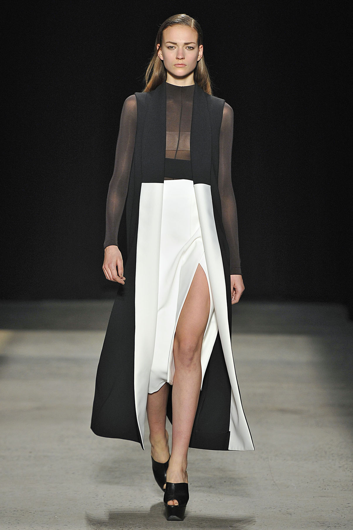 Look 1 Black/chalk wool/silk sleeveless coat with ebony sheer jersey top and white scuba crepe skirt.
