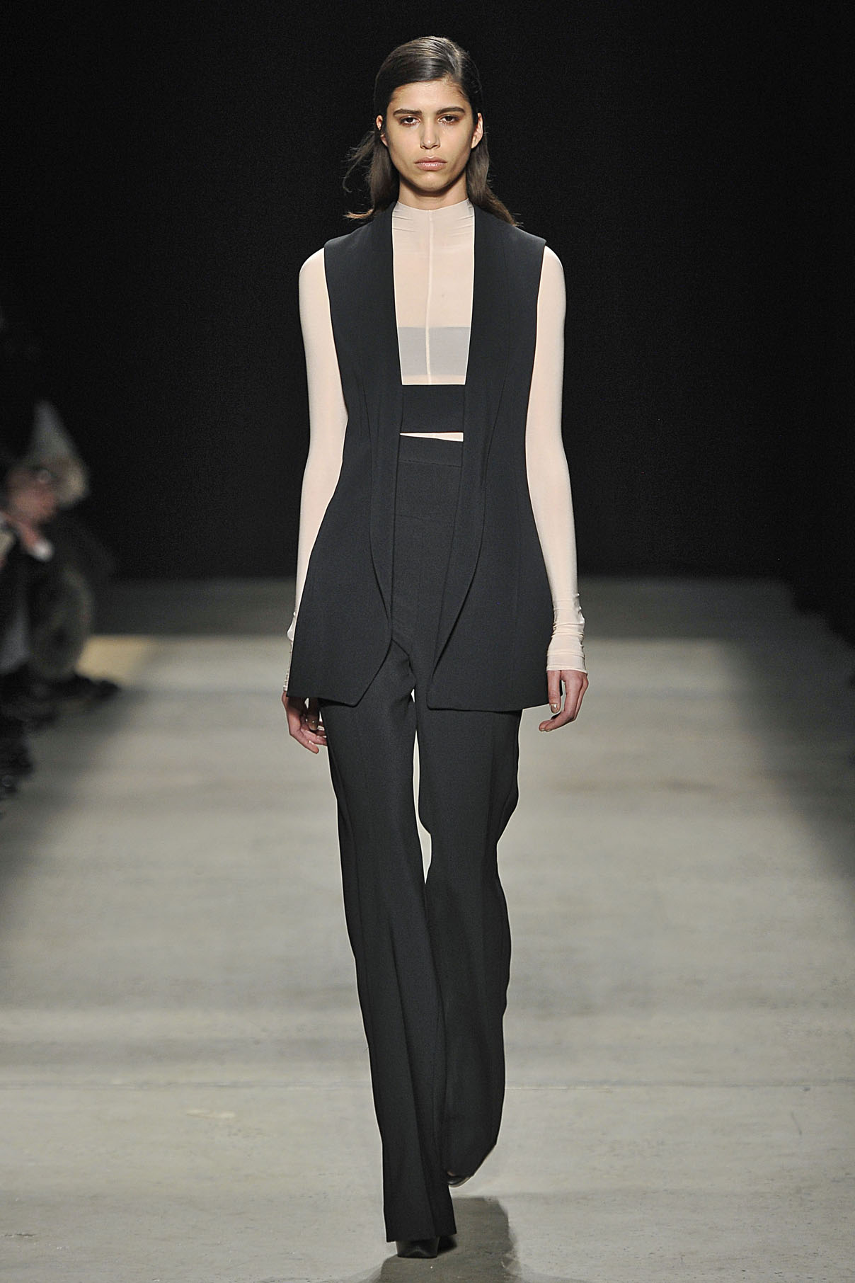 Look 5 Black crepe suit with nude sheer jersey top.