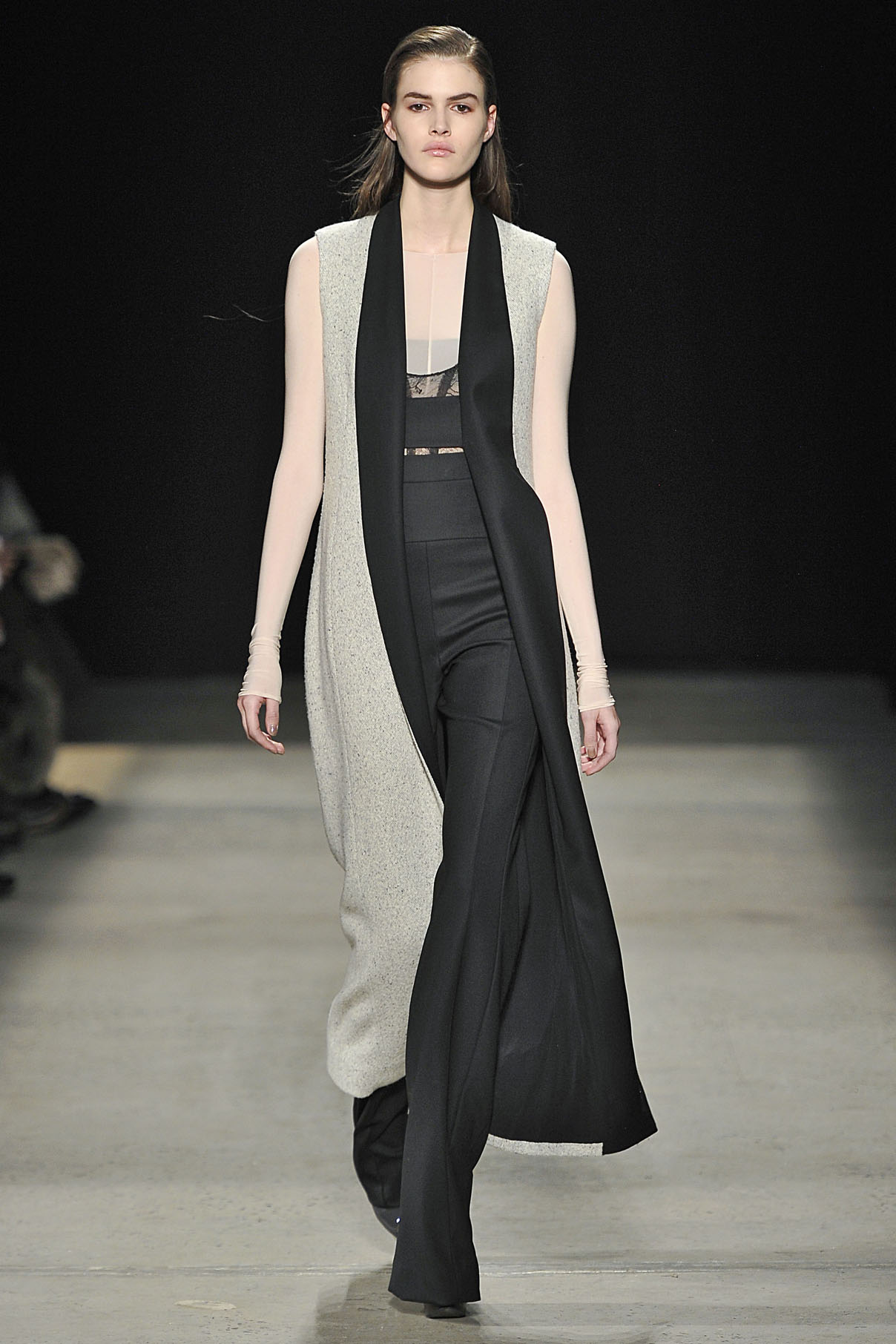 Look 24 Silver tweed/black wool sleeveless coat over nude sheer jersey top with black lace bodysuit and  black wool pant.