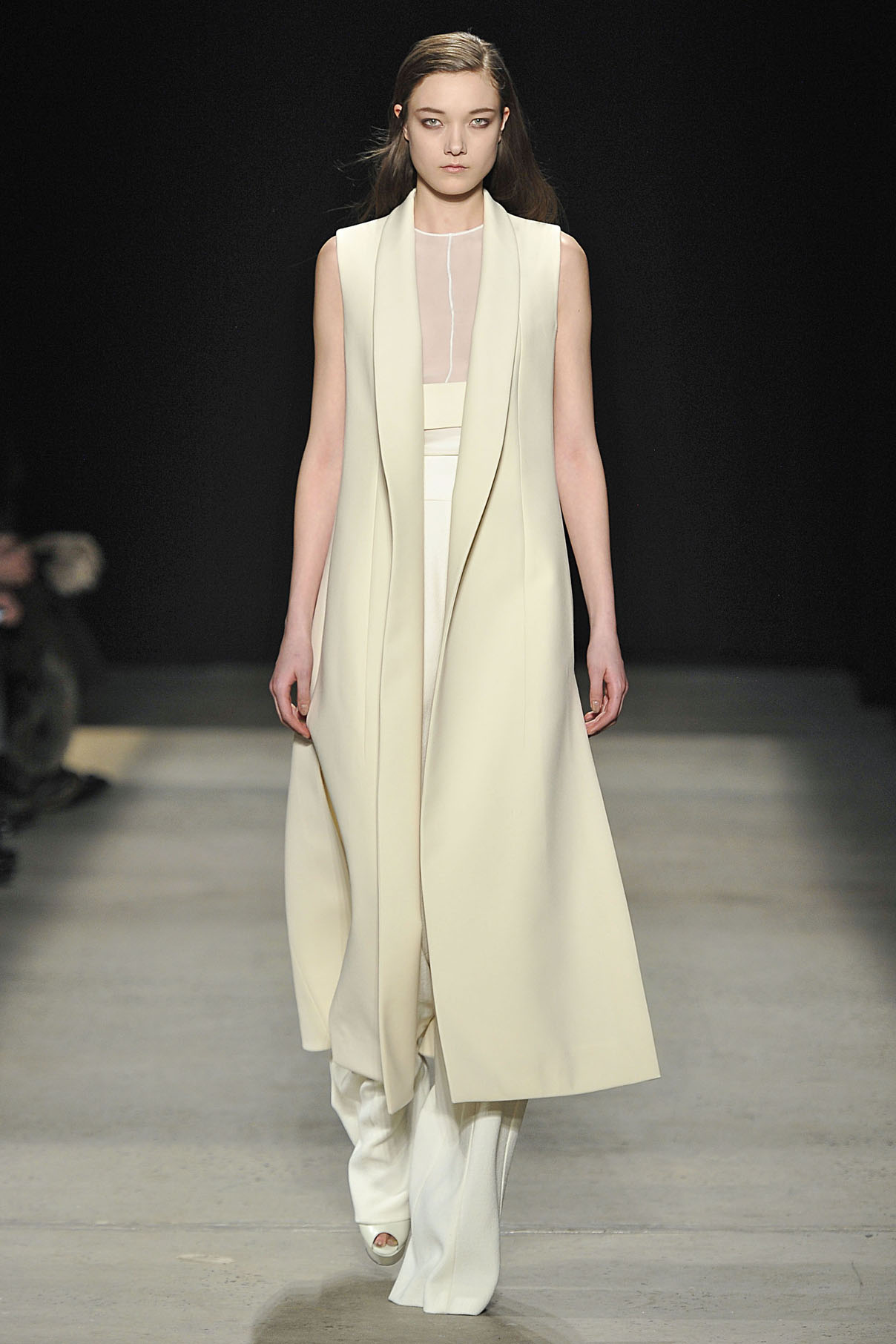 Look 30 Ivory bonded wool sleeveless coat with  ivory silk top and chalk wool crepe pant.