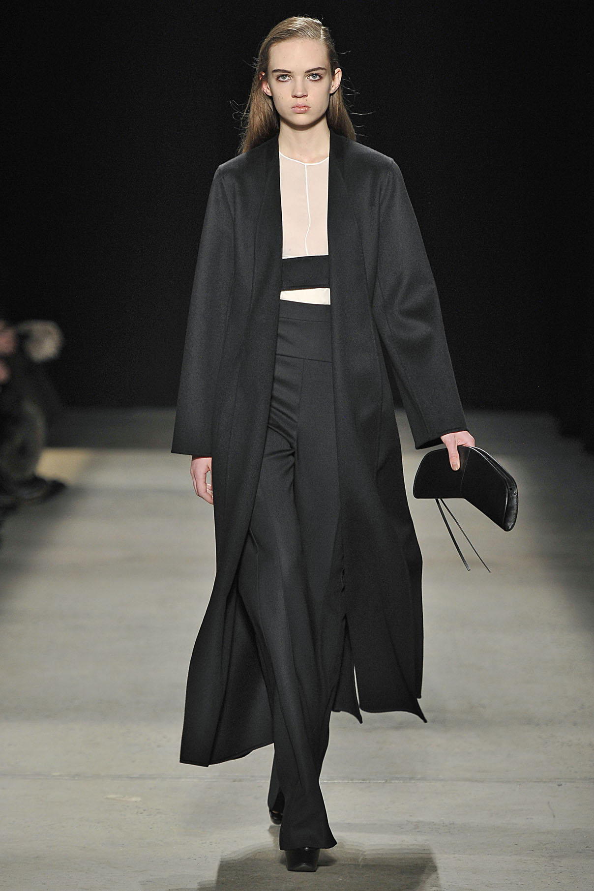 Look 31 Black wool cashmere double face coat with ivory silk top and black wool pant.
