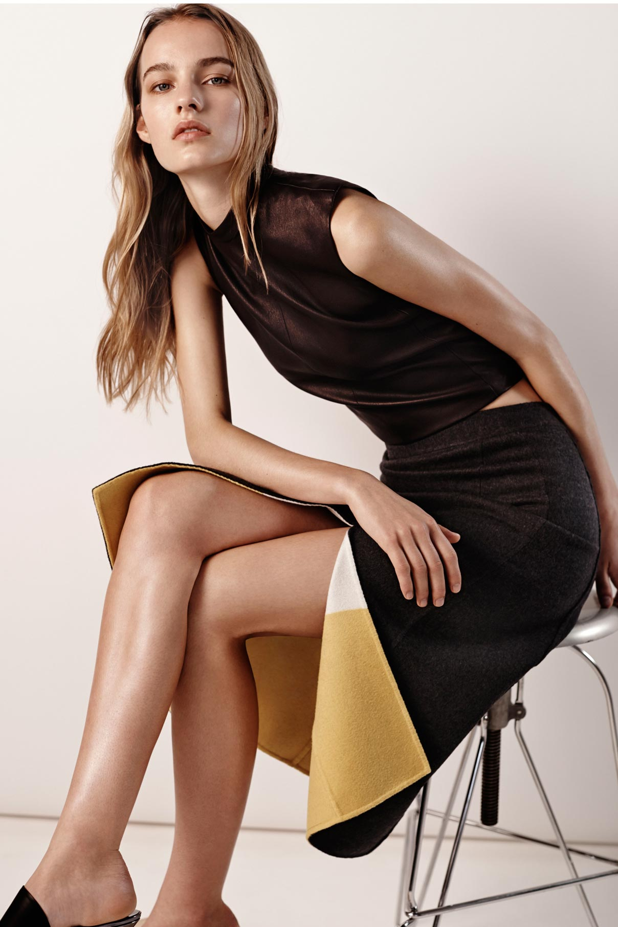 Look 4 Black leather top with grey/yellow/natural double face wool skirt.