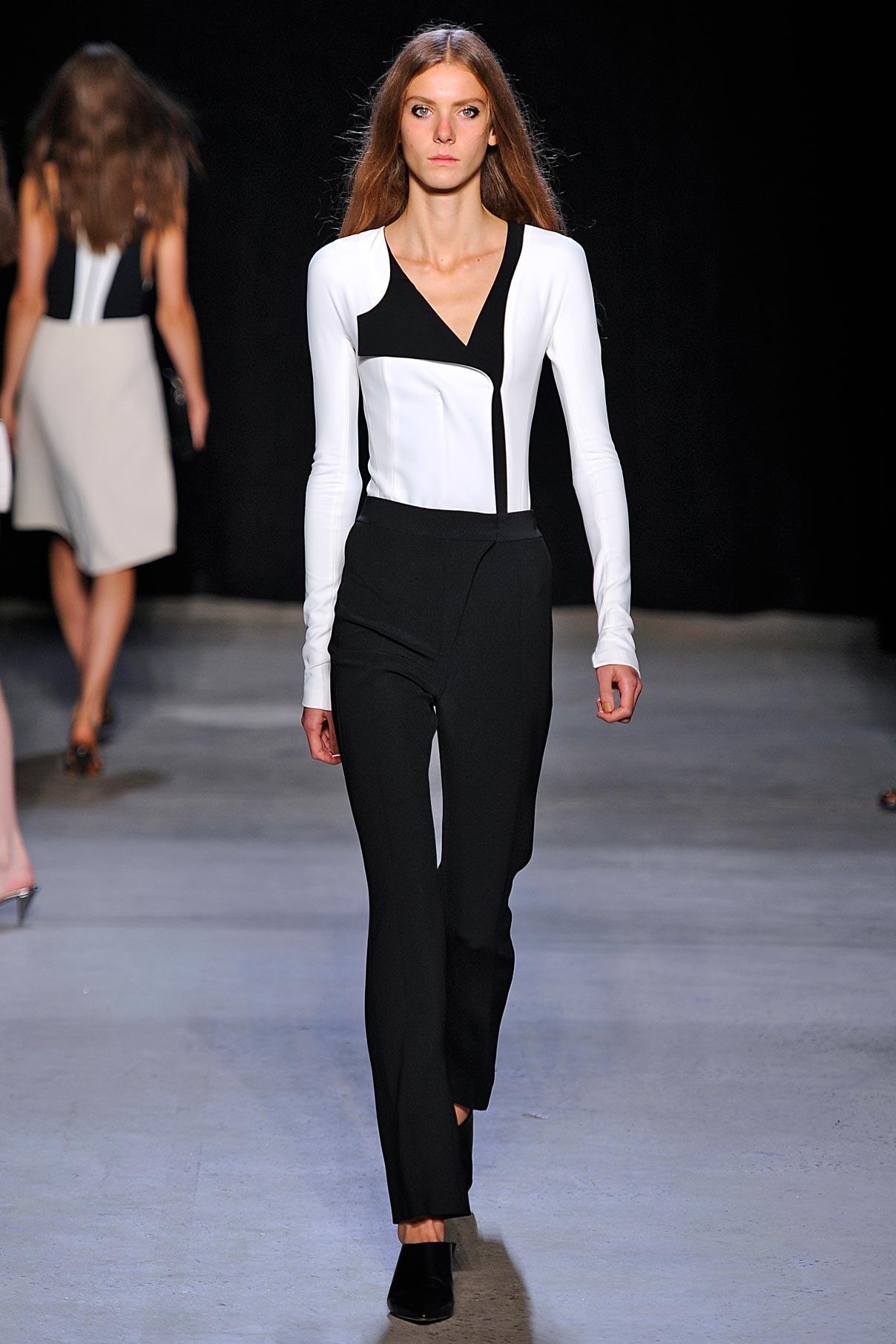 Look 7  White/black scuba jacket with black trouser.