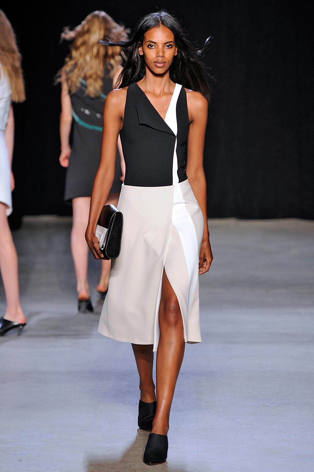 Look 16 Black scuba top with stone/white skirt.