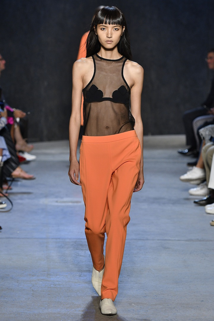 Narciso Rodriguez Spring 2017 collection. Black lotus knit tank with safety orange double constructed wool track pant.