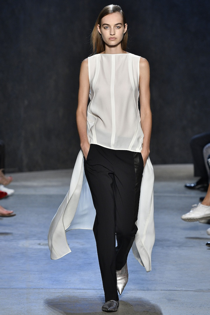 Narciso Rodriguez Spring 2017 collection. White pebble silk evening top with black double constructed wool trouser.