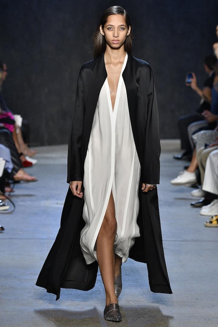 Narciso Rodriguez Spring 2017 collection. Black bonded satin cardigan coat over white pebble silk cardigan dress.