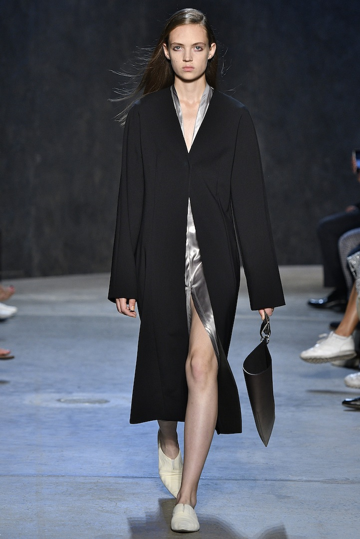 Narciso Rodriguez Spring 2017 collection. Black double constructed wool coat over mercury coated silk/satin cardigan dress.