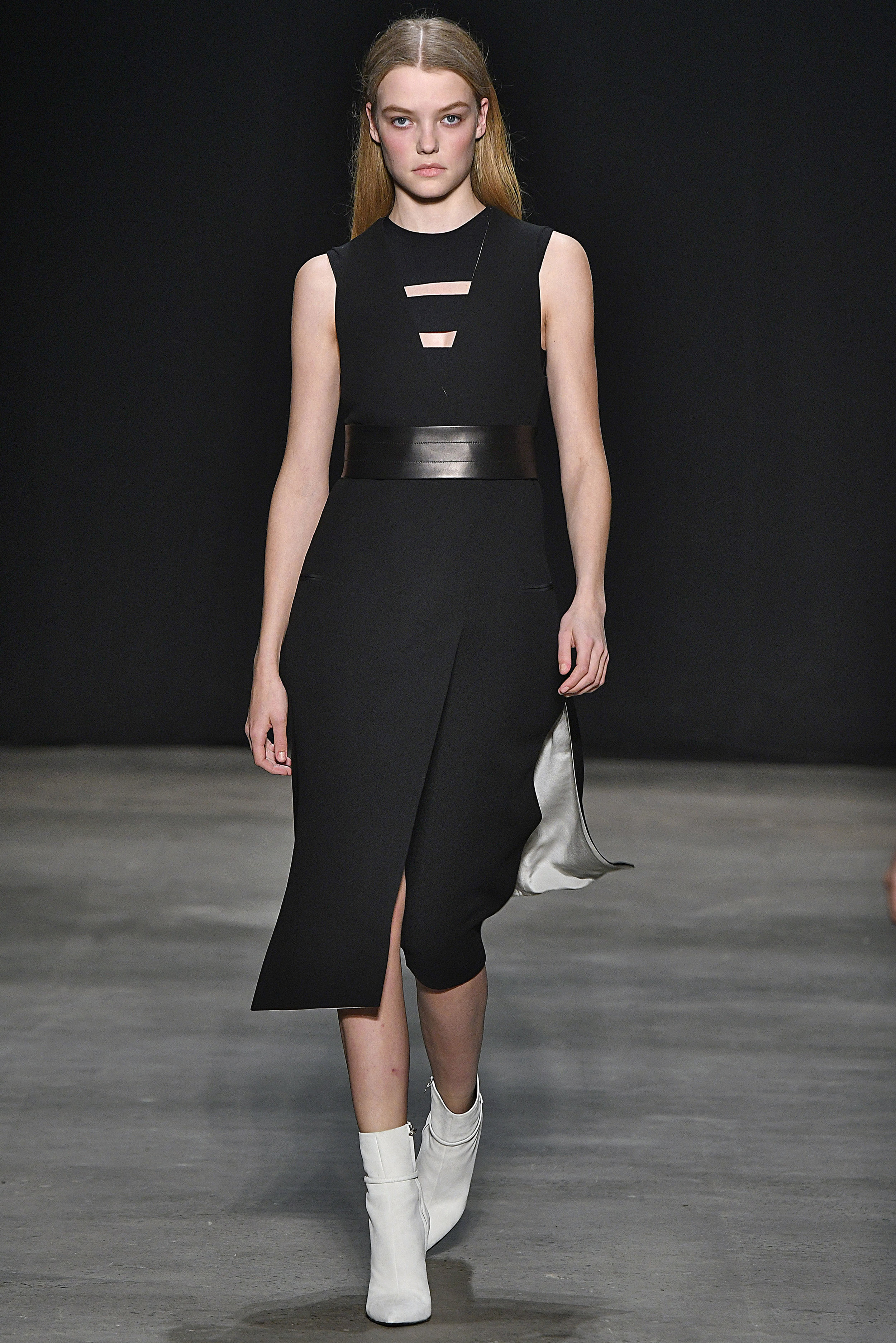 Narciso Rodriguez Fall 2017 collection. Black wool gauze vest dress with black double knit band top.