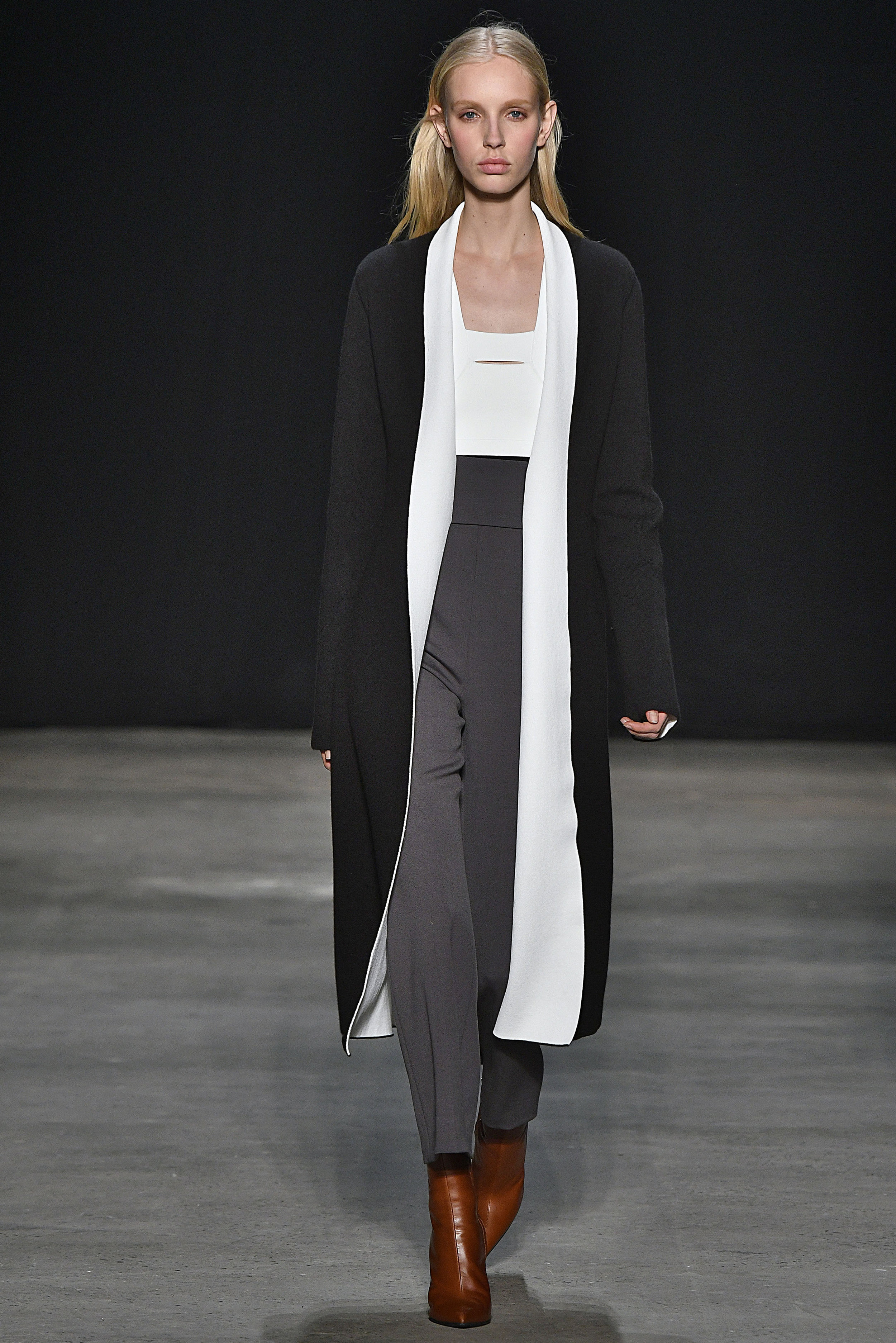 Narciso Rodriguez Fall 2017 collection. Black cashmere/pale blue double knit coat over pale blue/black knit top with slate wool barathea pant.
