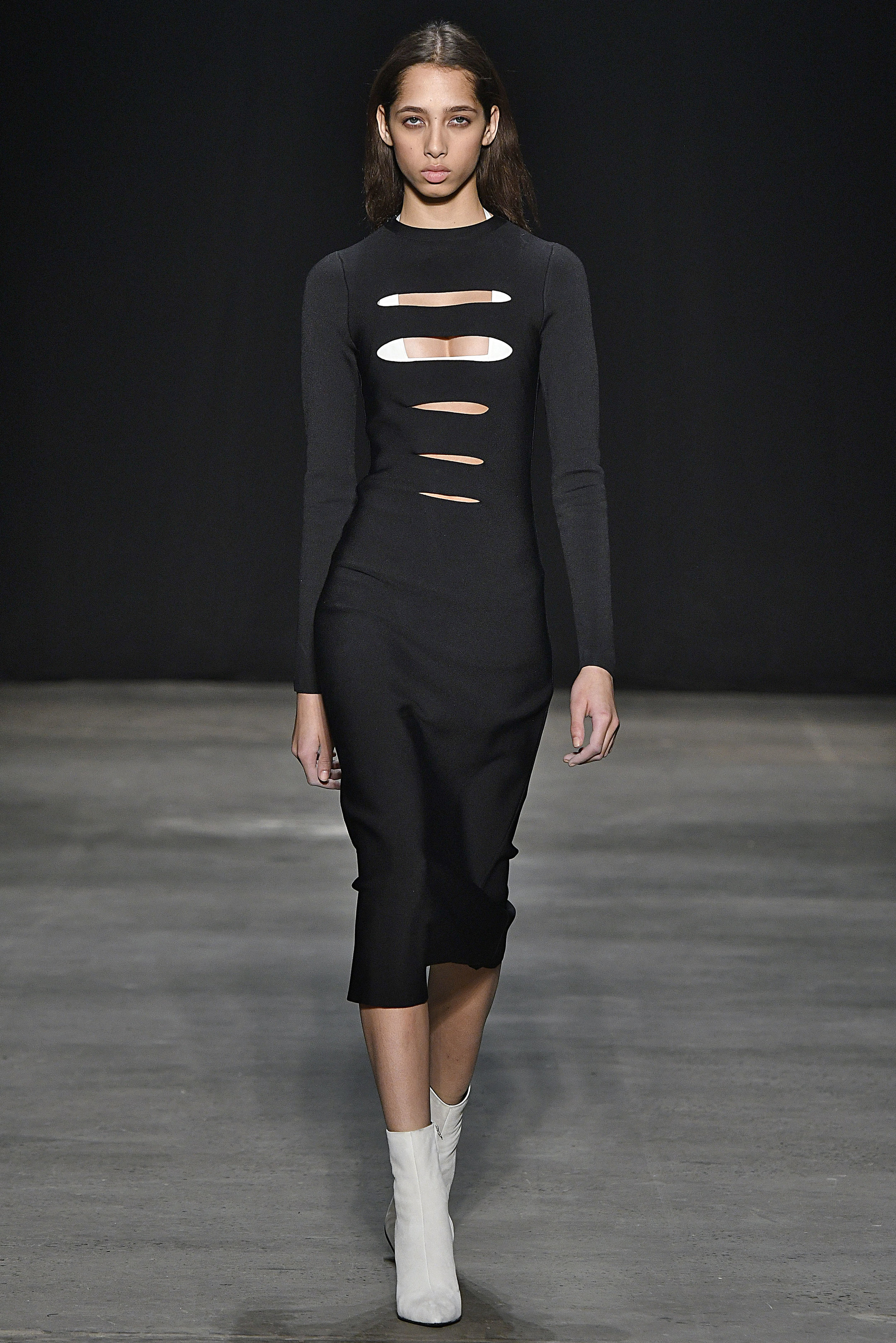 Narciso Rodriguez Fall 2017 collection. Black double knit band dress with white silk sling bra.