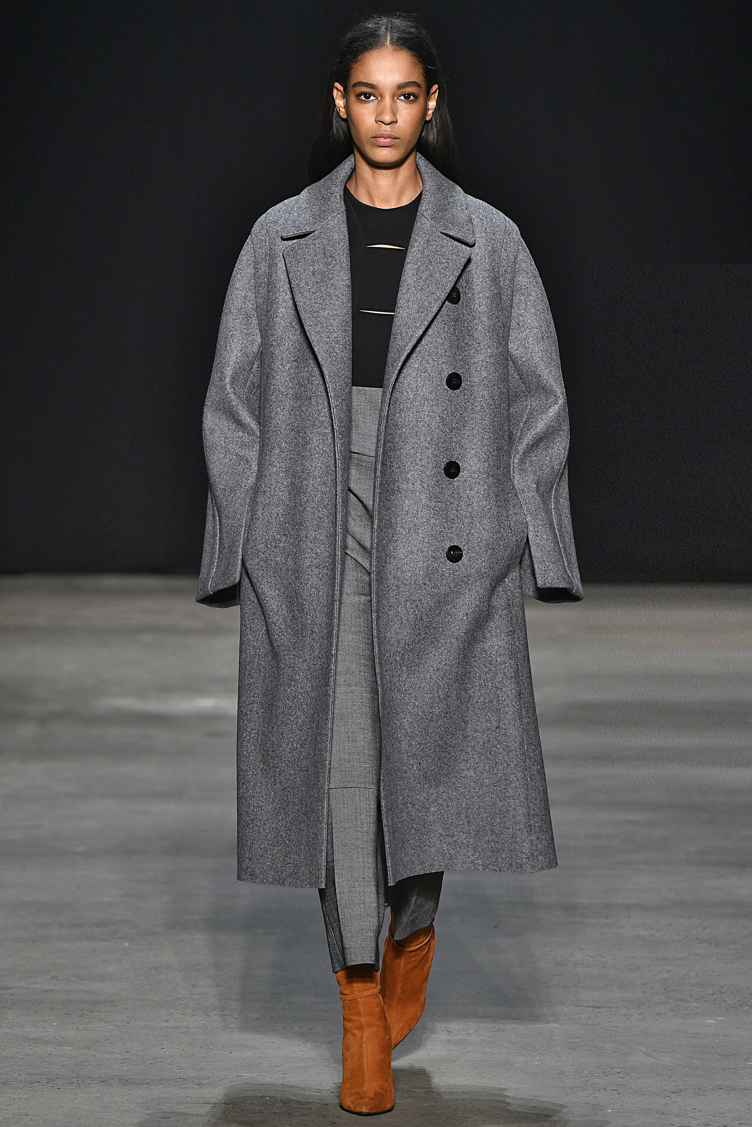 Narciso Rodriguez Fall 2017 collection. Grey melange pressed wool coat over black/charcoal leather and wool jumpsuit.