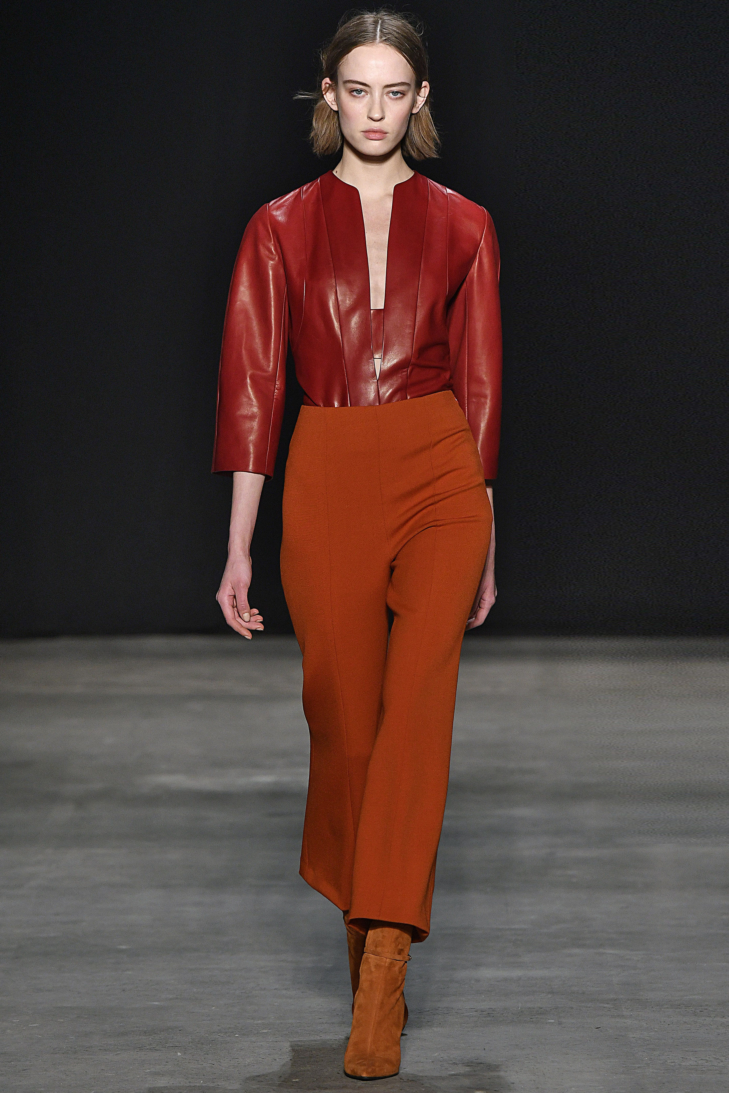 Narciso Rodriguez Fall 2017 collection. Oxblood leather top with crimson wool barathea pant.