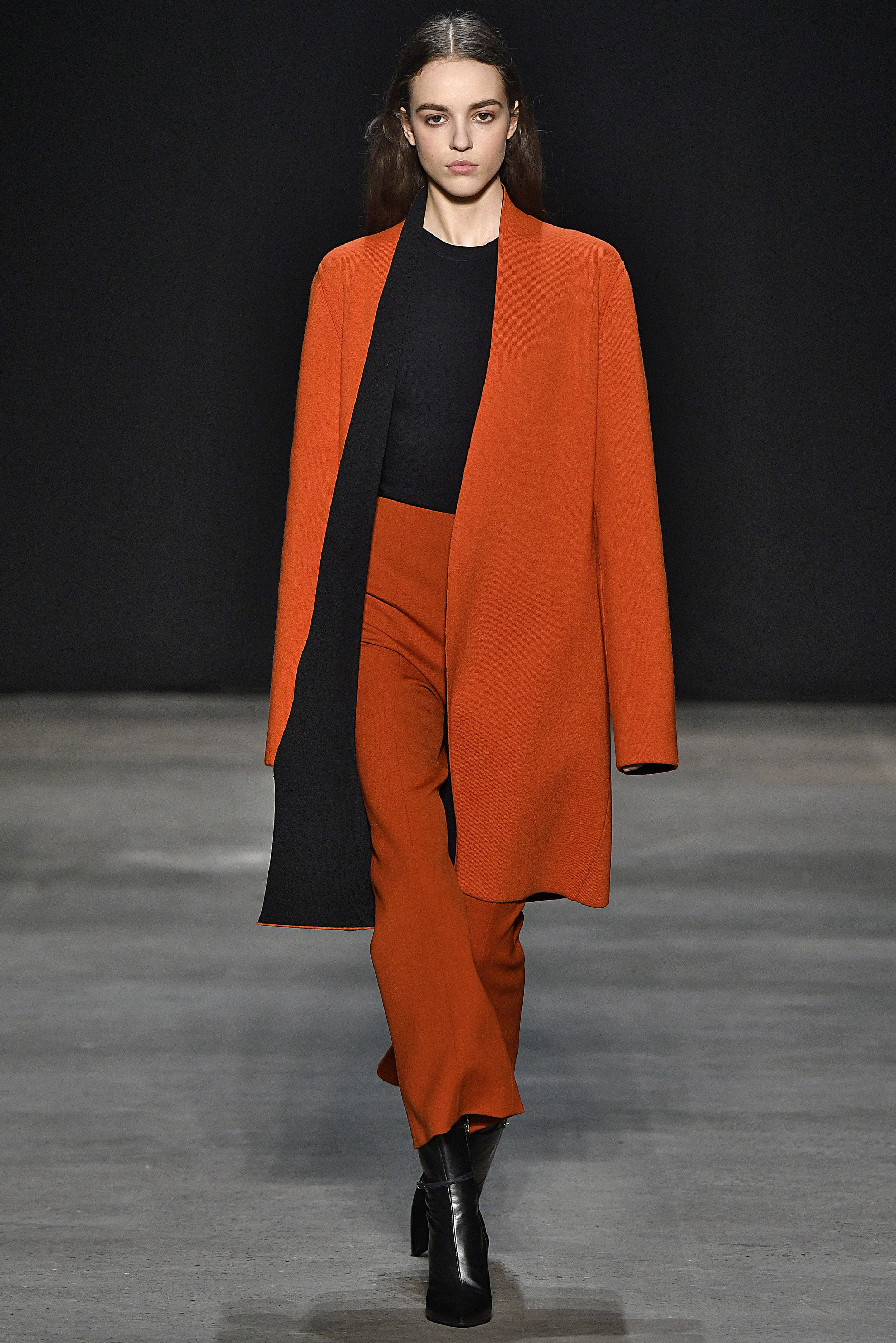 Narciso Rodriguez Fall 2017 collection. Red cashmere/black double knit coat over black double knit top with crimson wool barathea pant.