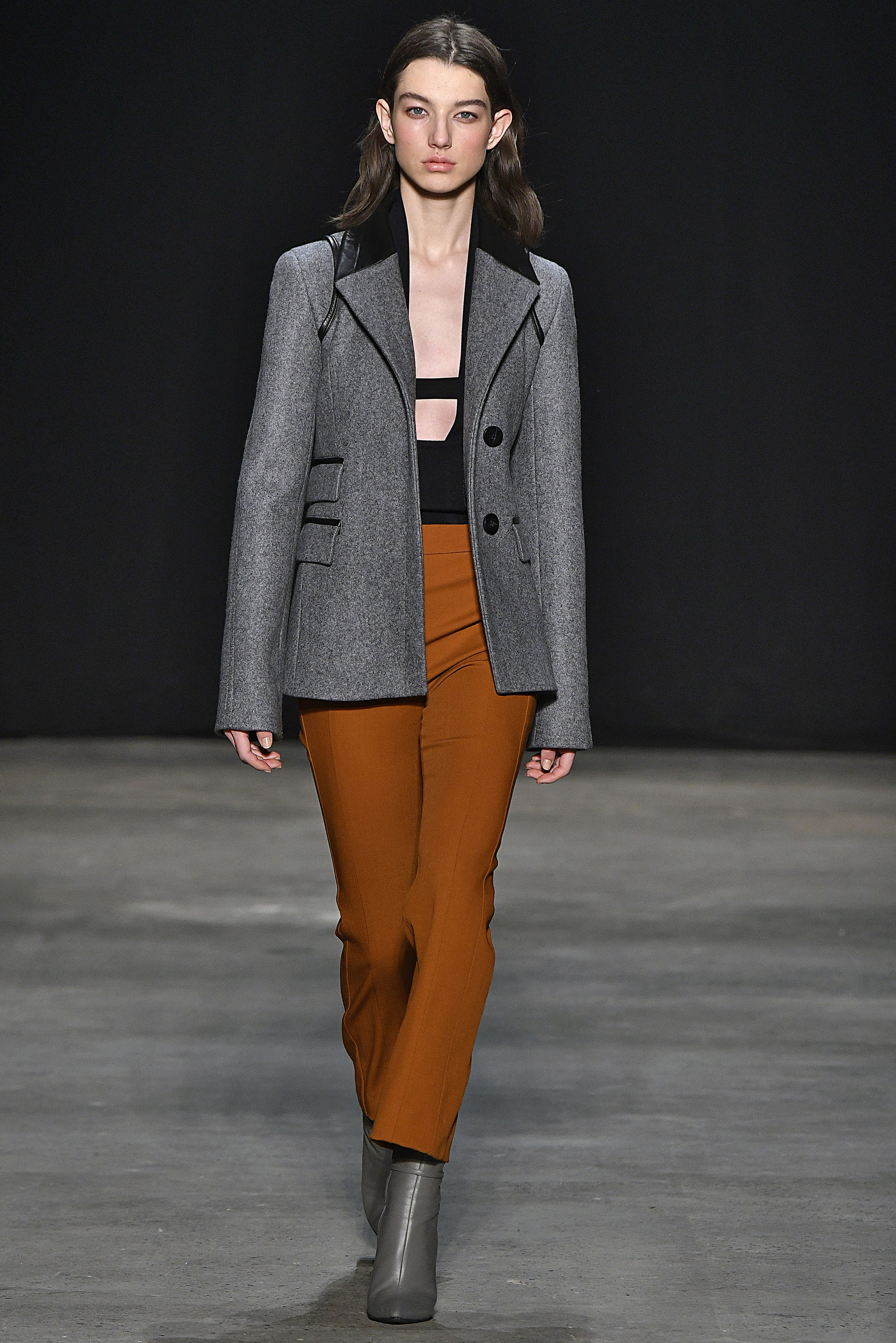 Narciso Rodriguez Fall 2017 collection. Grey melange pressed wool jacket over black double knit halter with copper wool gabardine pant.