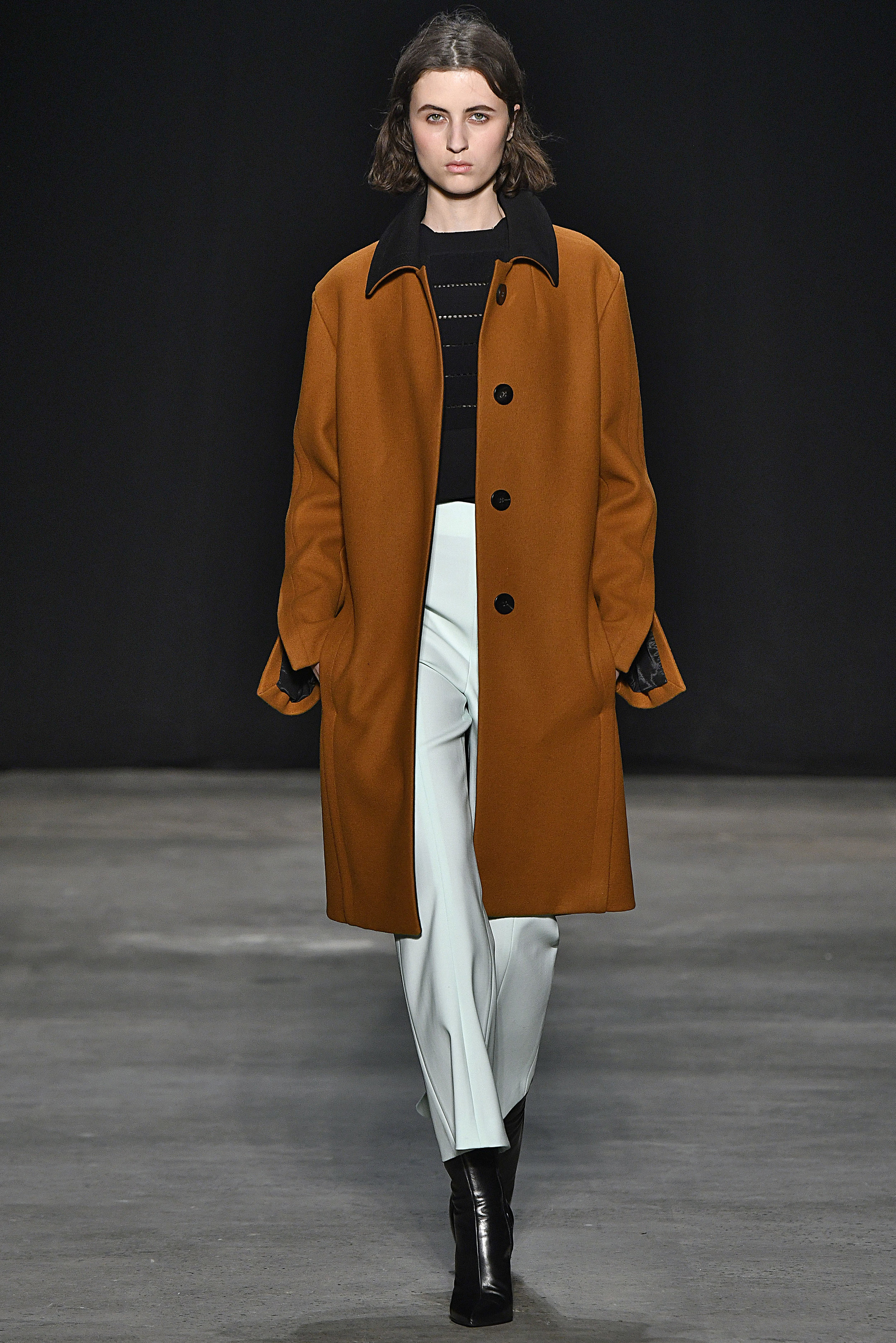 Narciso Rodriguez Fall 2017 collection. Copper/black pressed wool tab coat over black knit top with sky pressed wool pant.
