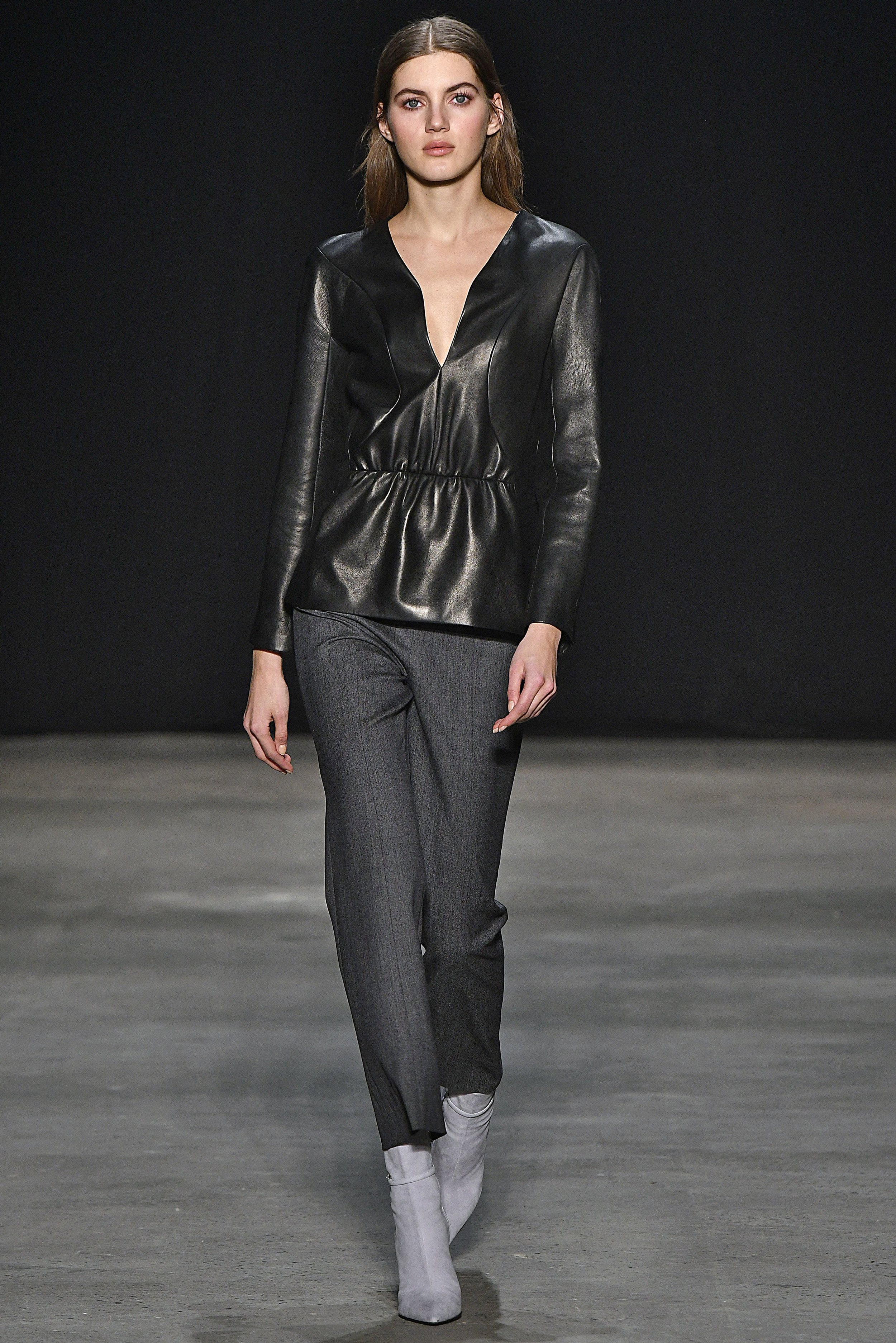Narciso Rodriguez Fall 2017 collection. Black leather top with grey melange wool pant.