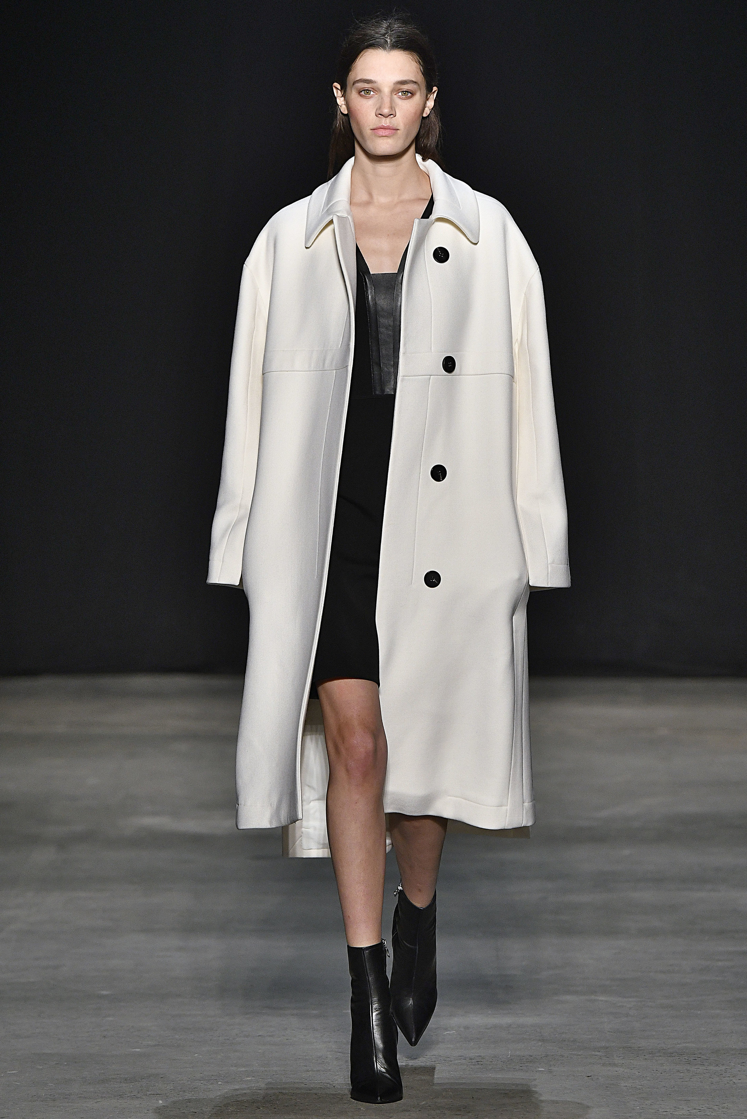 Narciso Rodriguez Fall 2017 collection. Ivory wool twill coat with black leather/wool barathea dress.