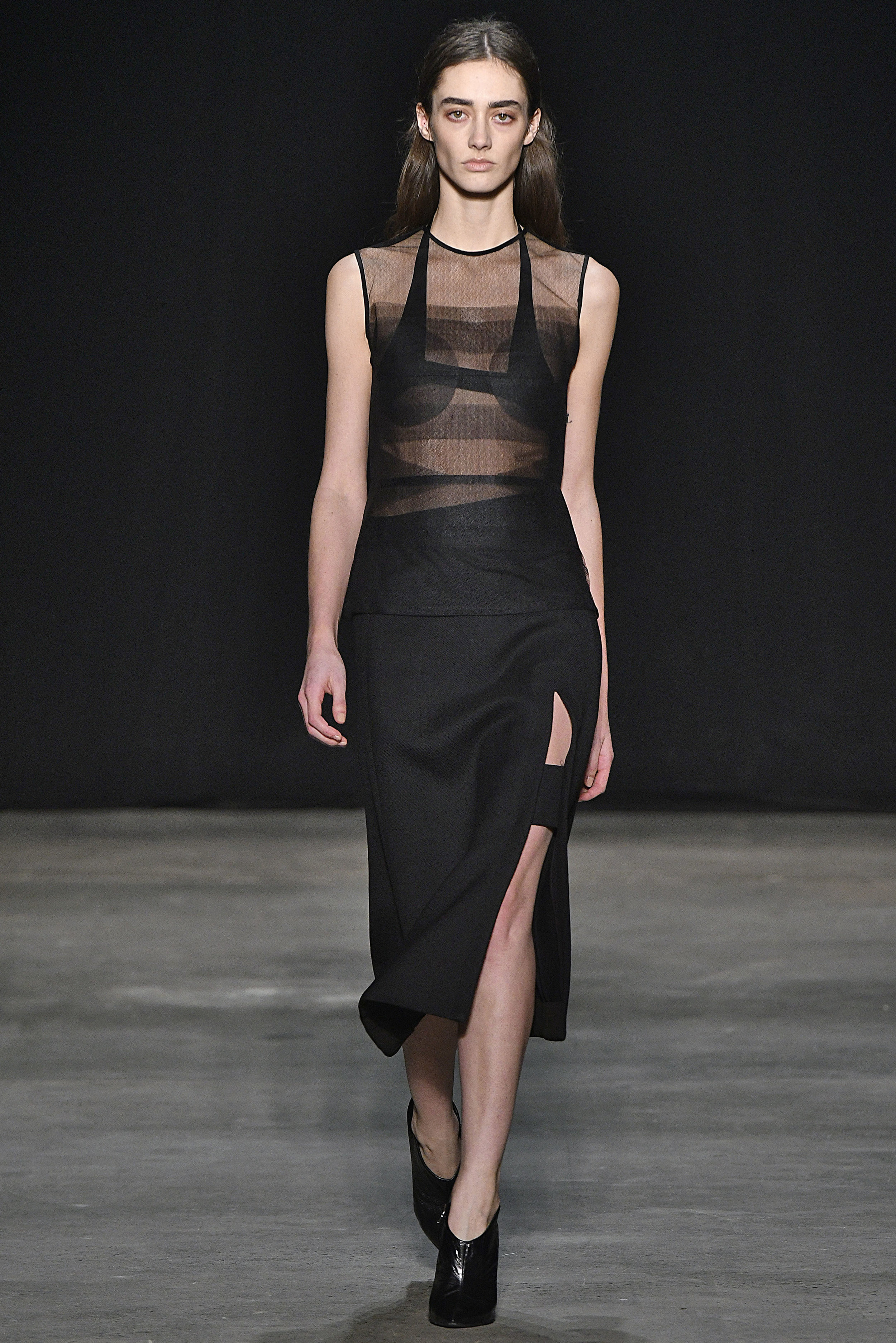 Narciso Rodriguez Fall 2017 collection. Black pressed tulle top over black silk sling bra  with black wool twill skirt.