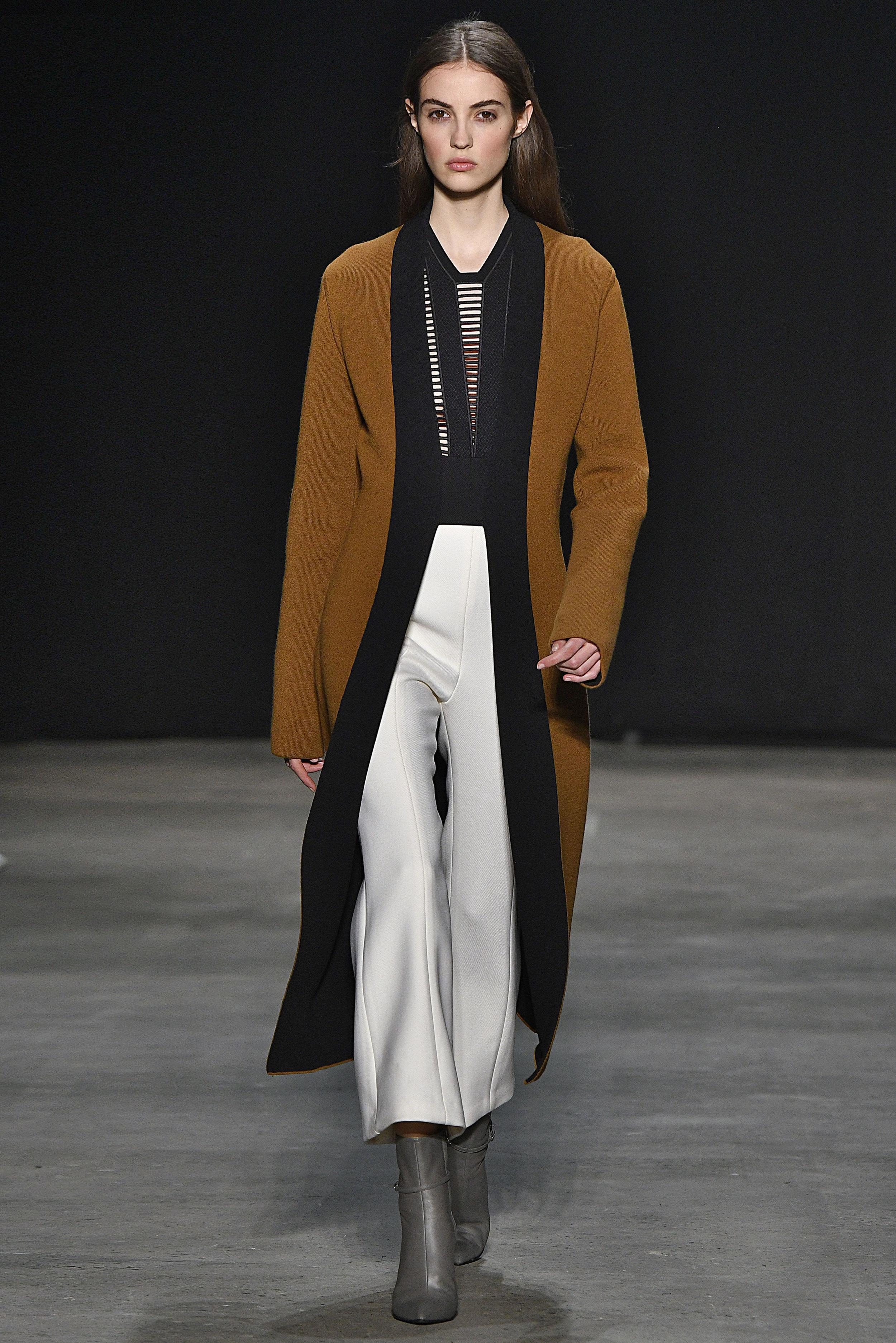 Narciso Rodriguez Fall 2017 collection. Copper cashmere/black double knit coat over black embroidered top with ivory wool twill pant.