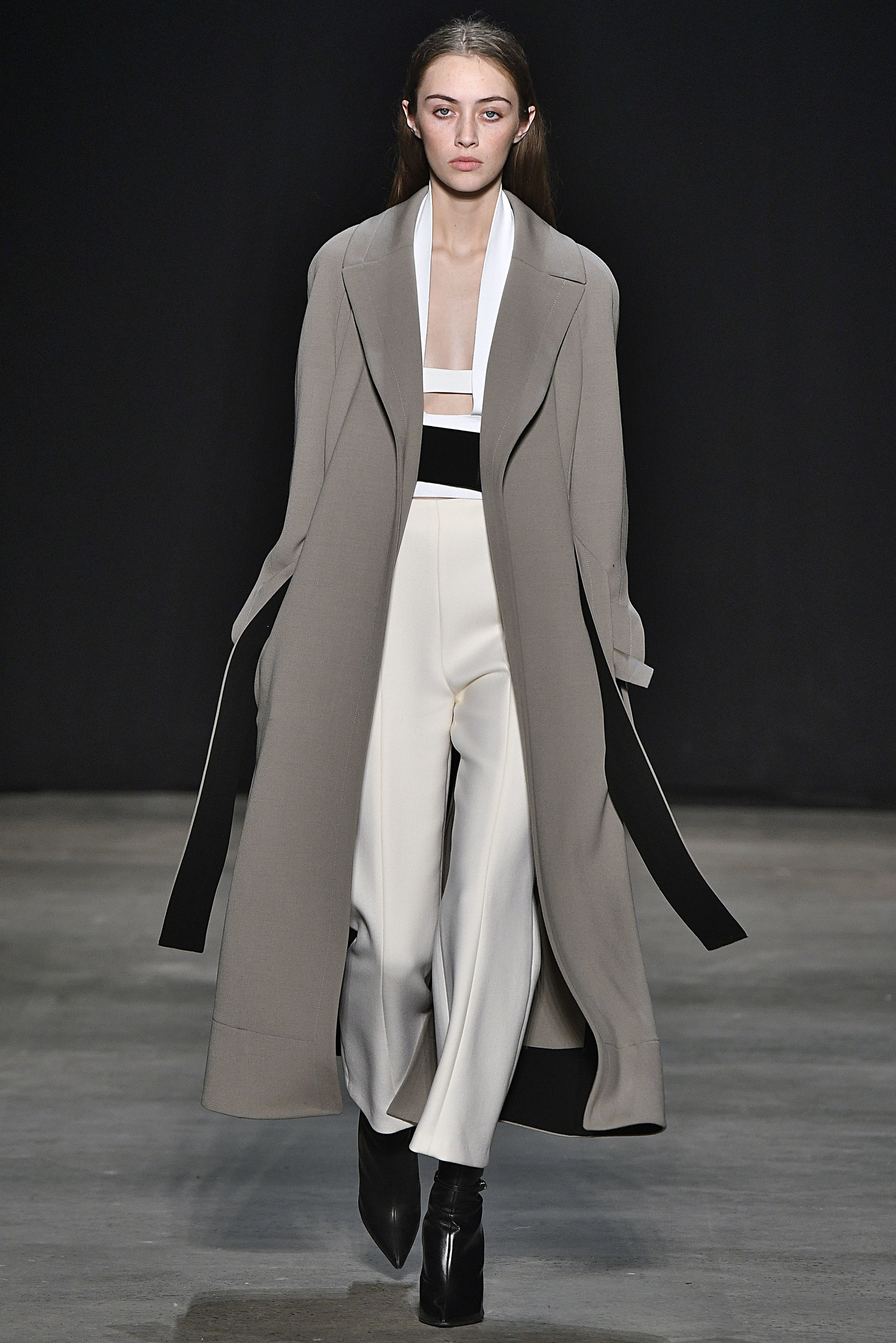 Narciso Rodriguez Fall 2017 collection. Khaki wool barathea trench coat over white double knit halter with ivory wool twill pant.
