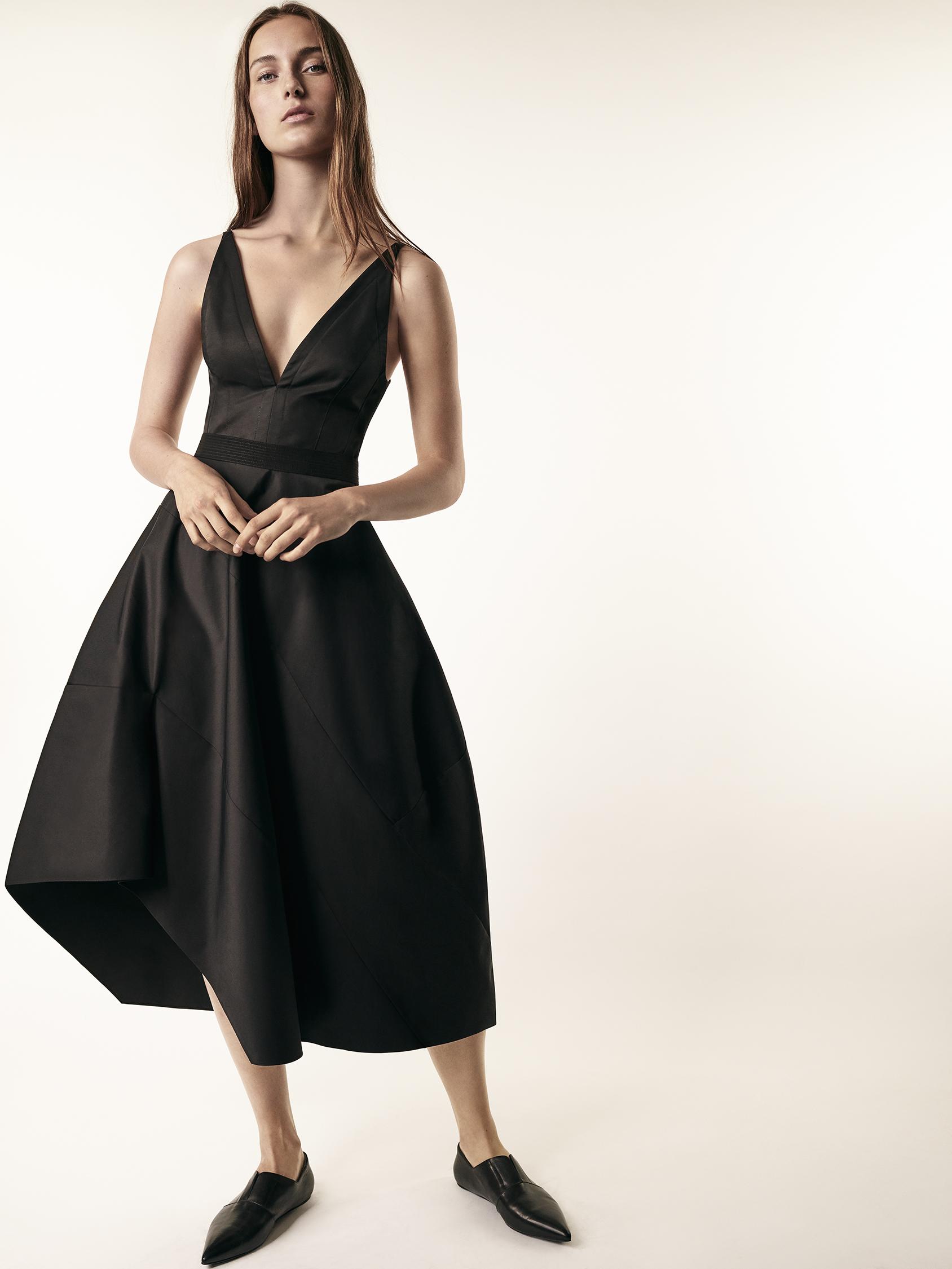 Look 2 Black cotton v-neck dress with full skirt.