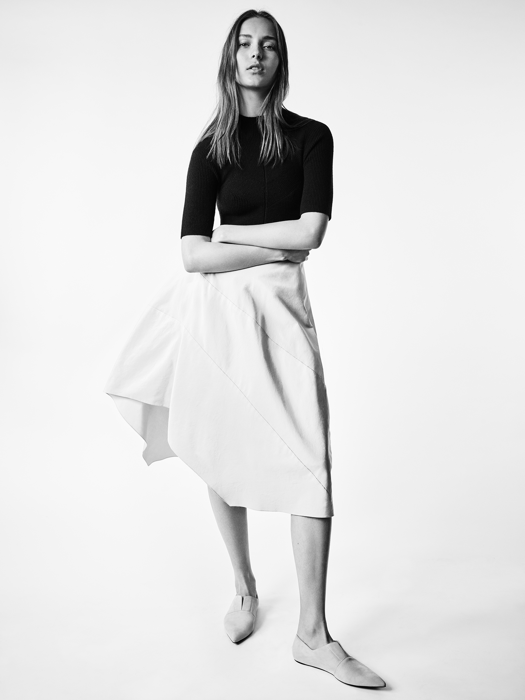 Look 8 Black knit short sleeve top with white silk faille full skirt.
