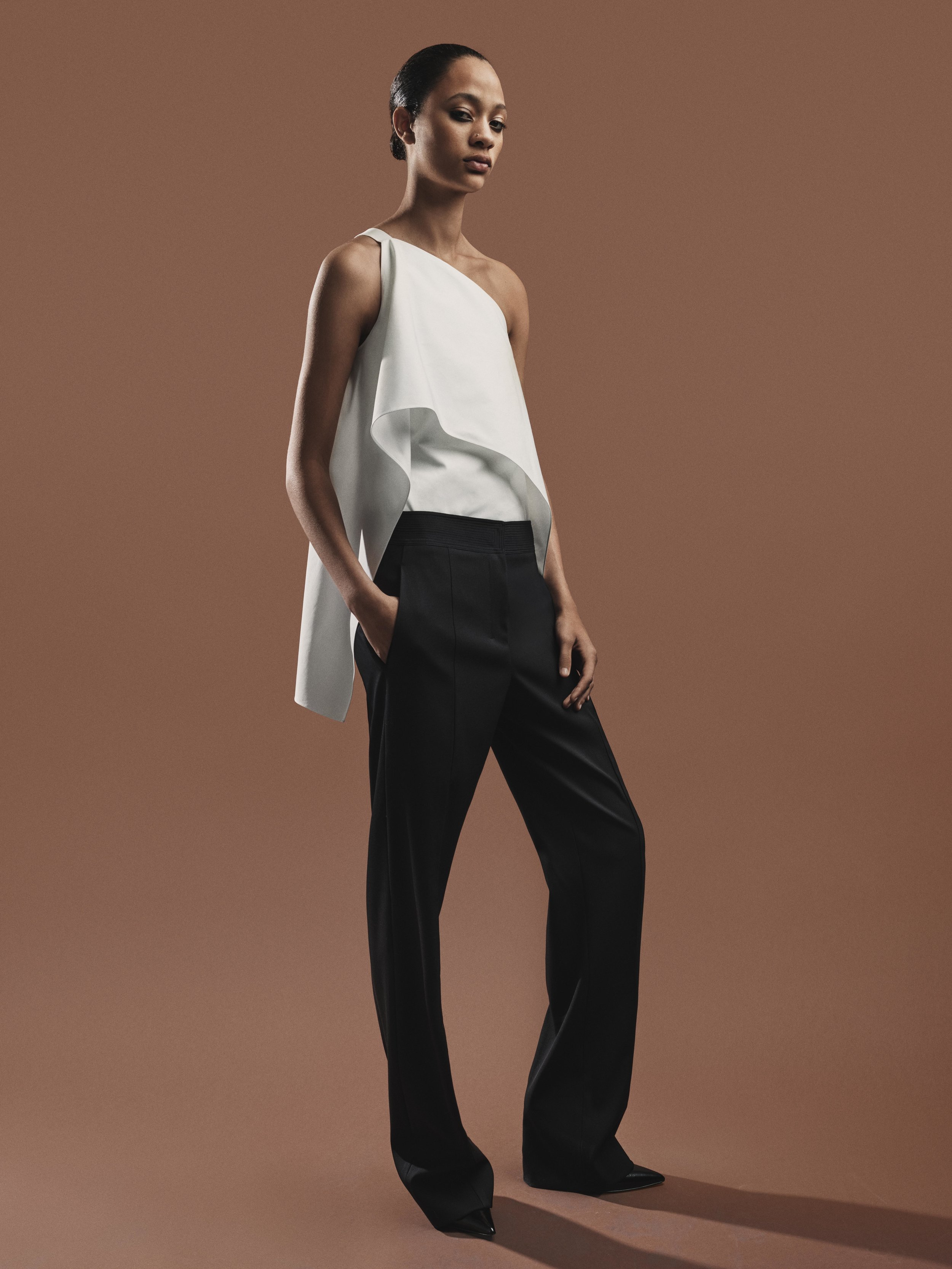 Look 4 White washed faille one-shoulder top with black wool gabardine pant.